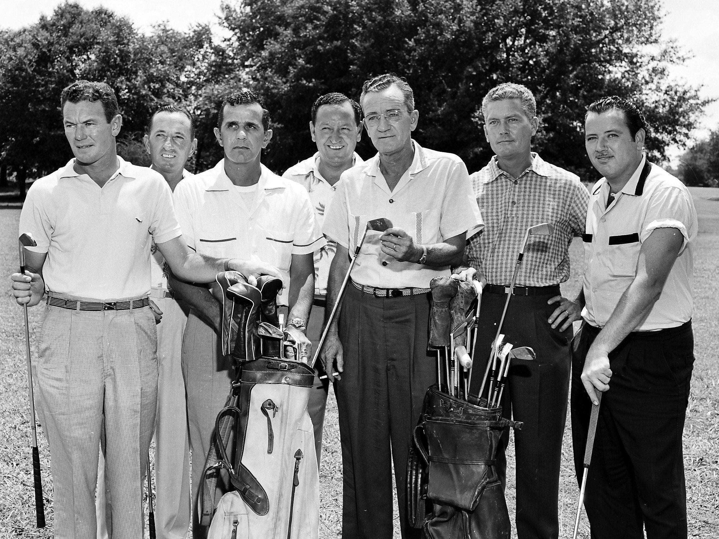 Meet the faculty for this town's biggest golfing school. The group, gathered here on 23 Jul 1955, will give several hundred youngsters the fundamentals of golf during the ninth annual Kid's Golf Clinic, starting at Overton Park on August 8. Pictured From Left are: Eddie Cook, pro at Audubon; Jake Fondren, pro at Colonial; Al Foster, pro at Overton; Dub Fondren, pro at Galloway; Buck Compton, driving range pro; Pat Abbott, pro at Memphis Country Club and Justin Reed, pro at Riverside. Others (Not Shown) who will help out are Arnold Mears, pro at Chickasaw; Jack Wenzler, pro at Ridgeway; Ed Creasy, pro at Pine Hill and Monk Joyner, pro at Chickasaw.