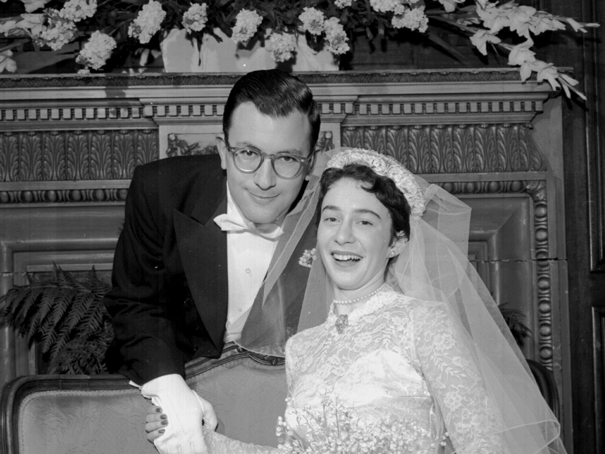 "Mr. and Mrs. Rudi Egon Scheidt pause in festivities at the Peabody following their wedding on 13 Feb 1954.  She is the former Miss Helen ""Honey"" Hohenberg, daughter of Mrs. and Mrs. Adolph Elkan Hohenberg of 54 White Station Road."