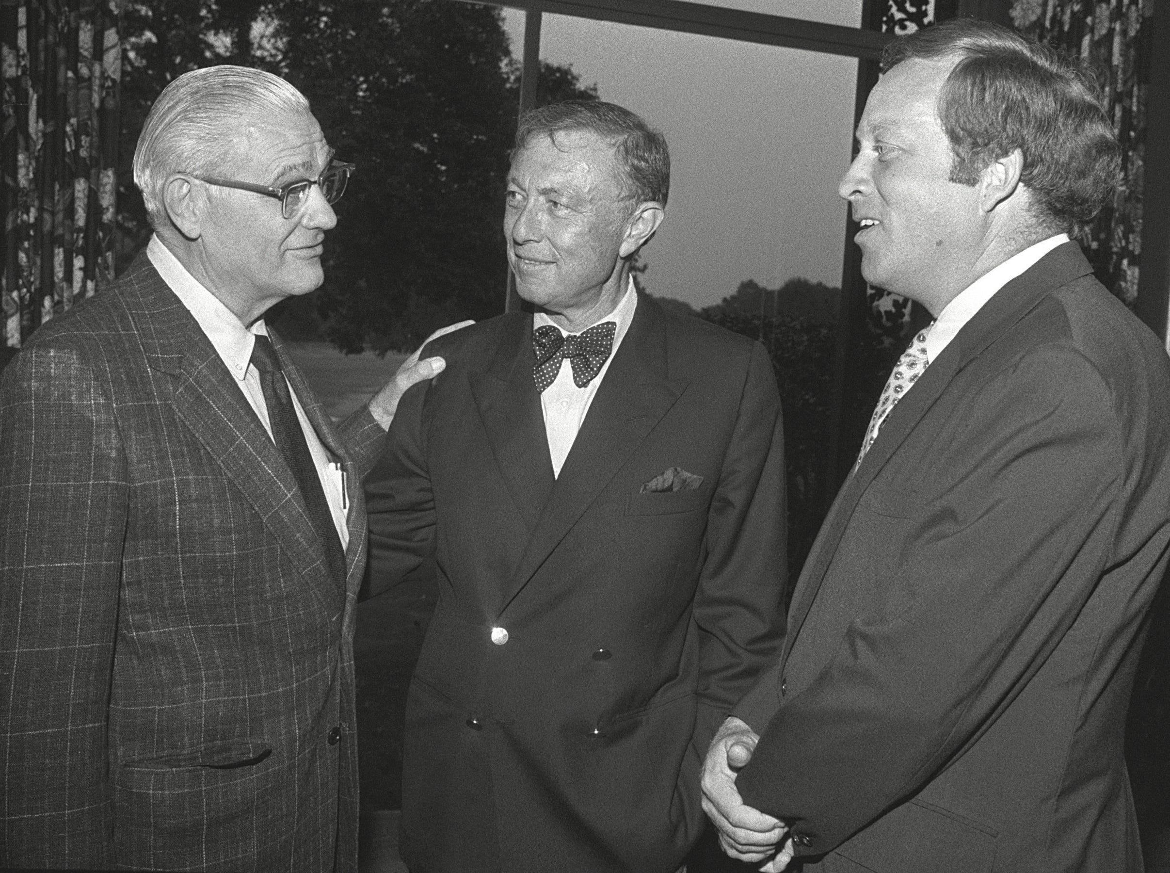 Former Ohio State University head football coach Woody Hayes (Left) visits with Tim Treadwell III (Center) and Reggie Barnes (Right) at the Touchdown Club of Memphis on 4 Oct 1982.  Hayes was the featured speaker.