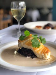 Roasted sea bass on black Thai rice with soy beurre blanc has been one of the most popular items at Tsunami since it was first put on the menu.