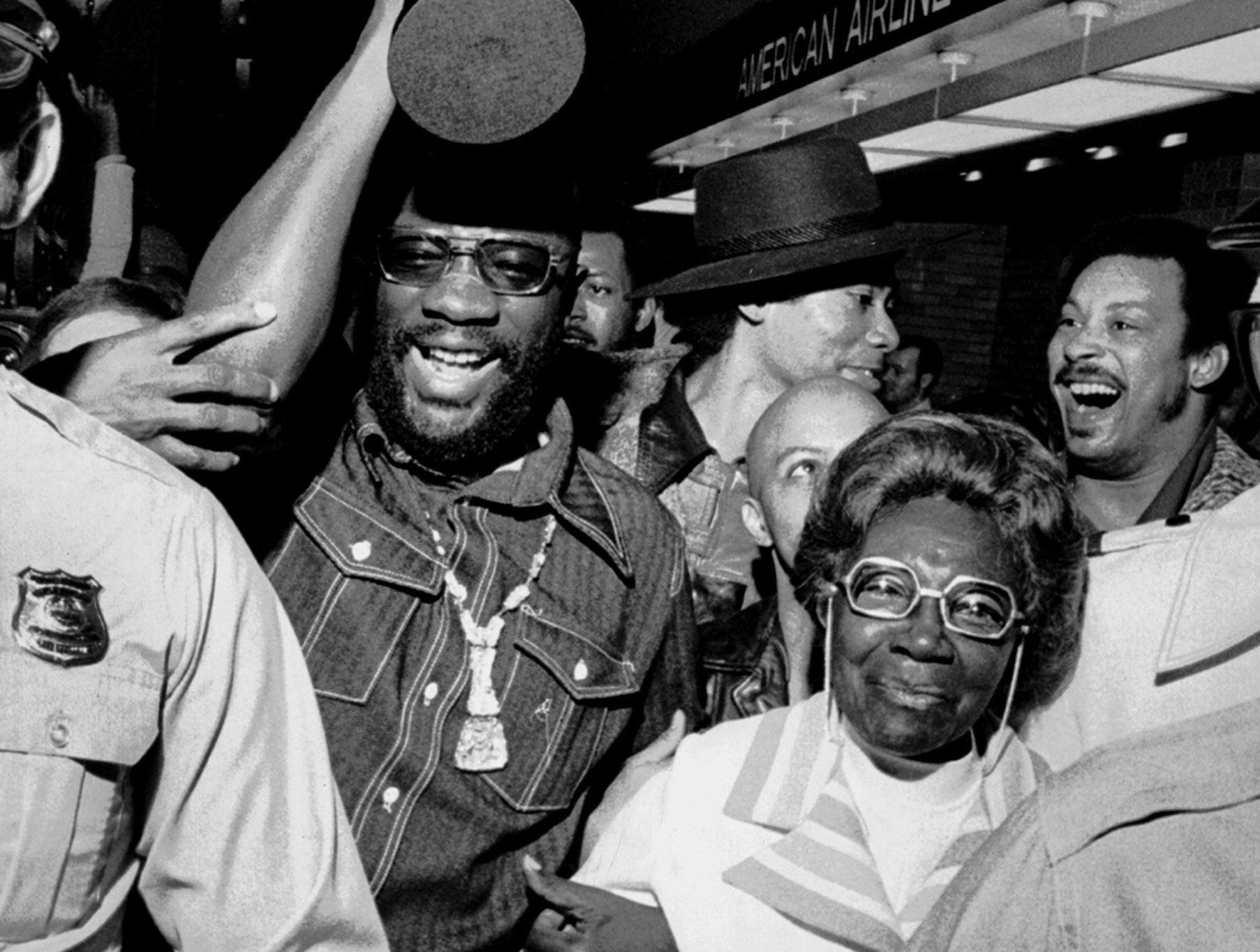 """With his Oscar in one hand and """"Mama Wade"""" in the other, Academy Award winner Isaac Hayes came home to Memphis April 11, 1972. At his side throughout the official welcoming ceremonies was Mrs. Rushia Wade, the grandmother to whom Hayes, 29, attributes his latest, and all other achievements. A crowd estimated at 1,000 screaming admirers filled Memphis Metropolitan Airport to greet Hayes, who won the Oscar for the best song, """"Theme from Shaft."""" In his acceptance in Hollywood the previous night, Hayes thanked his grandmother for """"keeping me on the paths of righteousness"""" and said that the Oscar was an 80th birthday present for her. Isaac Hayes was born on 20 Aug 42."""