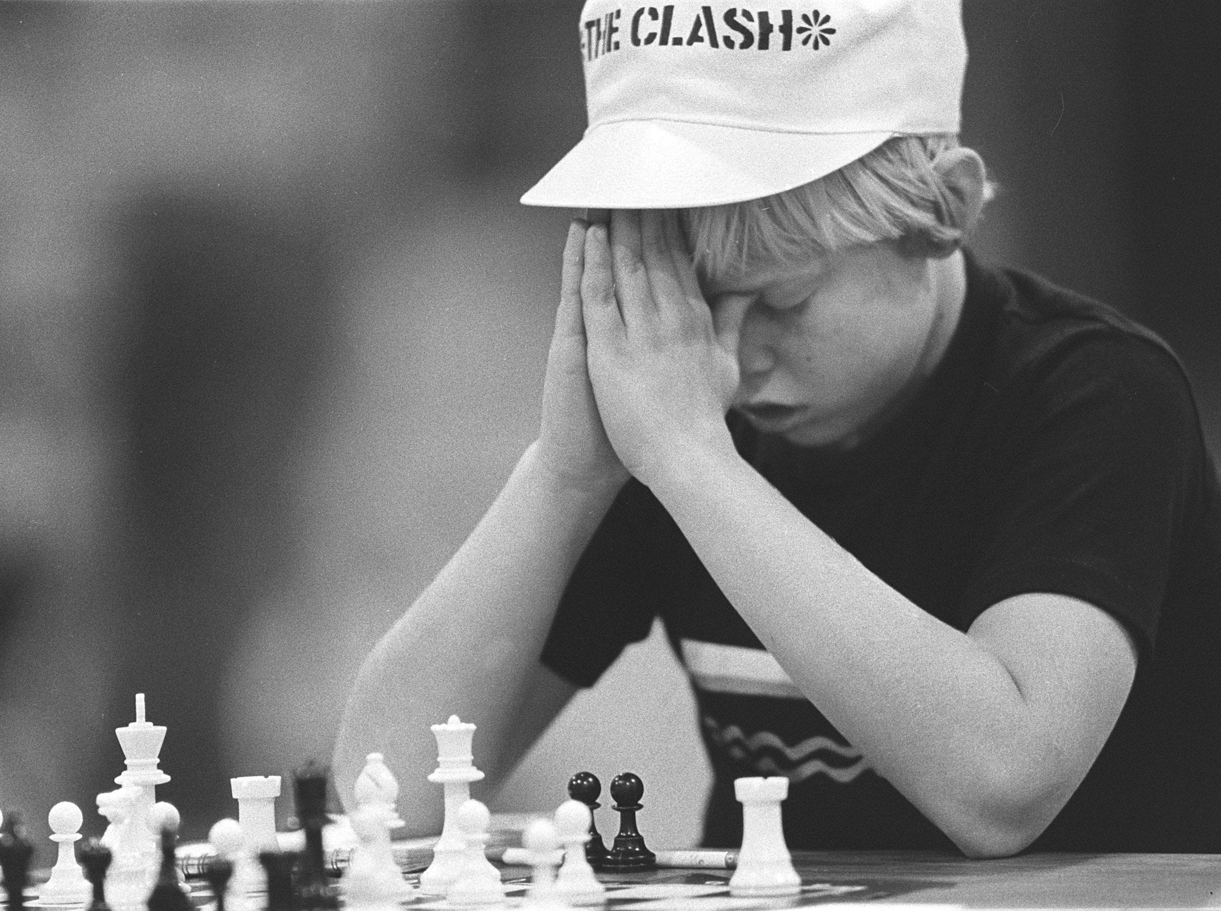Bo Bell, 11, thinks over his next move very cafefully.  The fifth grade student from Lausanne School was playing his fourth-round match in the scholastic chess championship at Auburndale School on 22 Oct 1983.