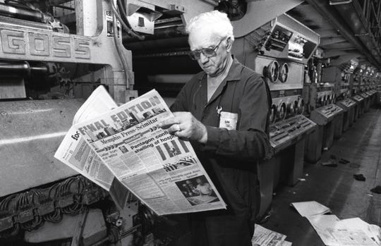 """The final Final Edition of the Memphis Press-Scimitar is viewed as it came off the presses at 495 Union Avenue by Durwood Wilburn on 31 Oct 1983. The final edition came off the presses at precisely 3:16 p.m.  Although the newspaper's circulation had dropped to 74,000, special requests for the collector's item increased the final press run to 125,000 newspapers. In addition to the day's news, the  final edition numbered 38 pages and carried farewell stories from various members of the staff, a letter from President Reagan and a letter from Milton R. Britten, the editor. Splashed above the masthead in blocky, red letters were the words, """"FINAL EDITION.""""  The newspaper began publication in 1880."""