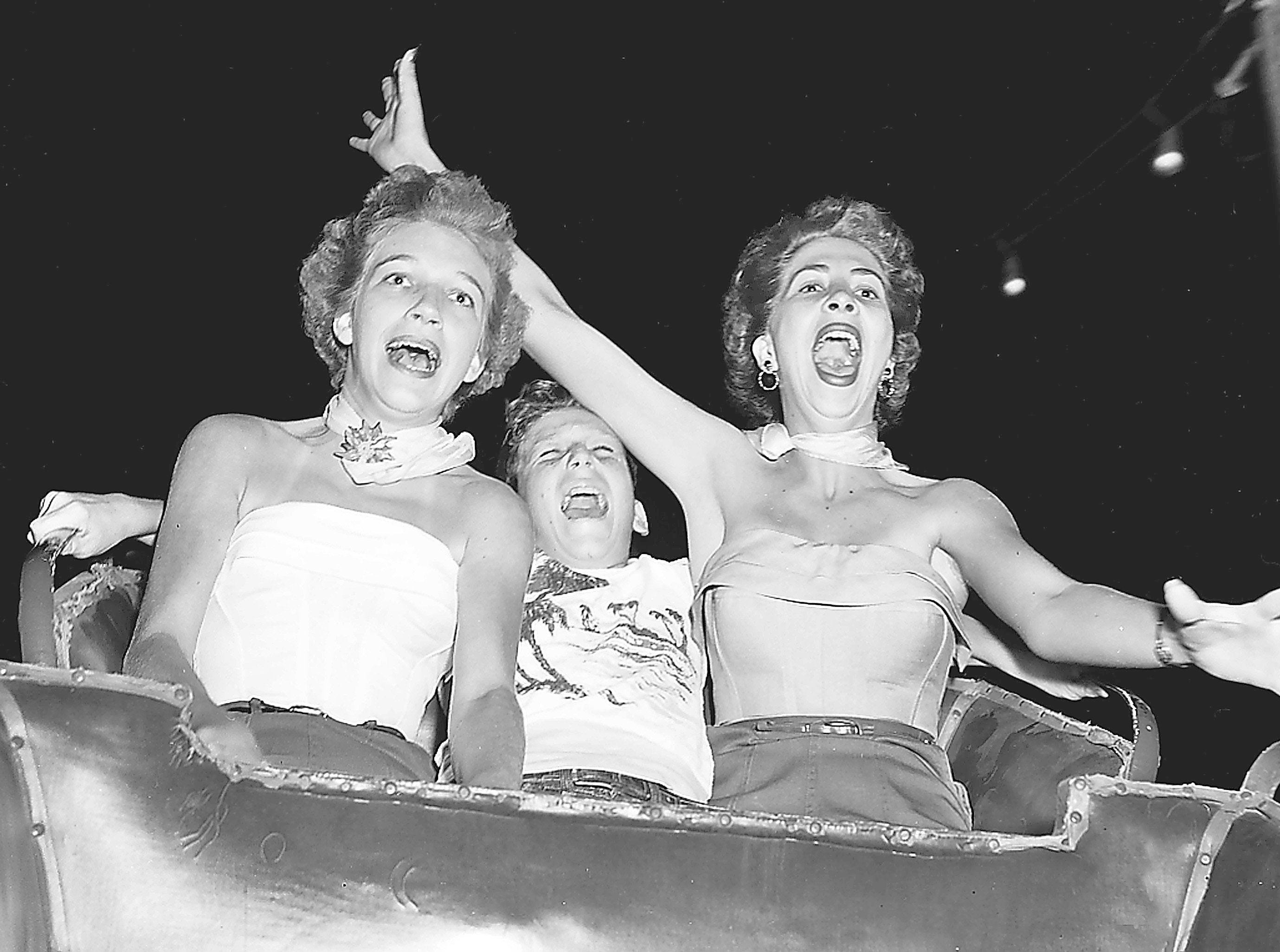 The nervous thrill of taking a dip on the Pippin at the Fairgrounds is etched on the faces of Sonja Enos, 15, left, Don Enos, 12, both of 2321 Hubbard, and Loretta Greathouse, 19, of Troy, Ala., on Aug. 22, 1953.