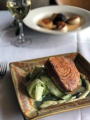 Spice-crusted tuna on cucumber salad with wasabi vinaigrette at Tsunami.
