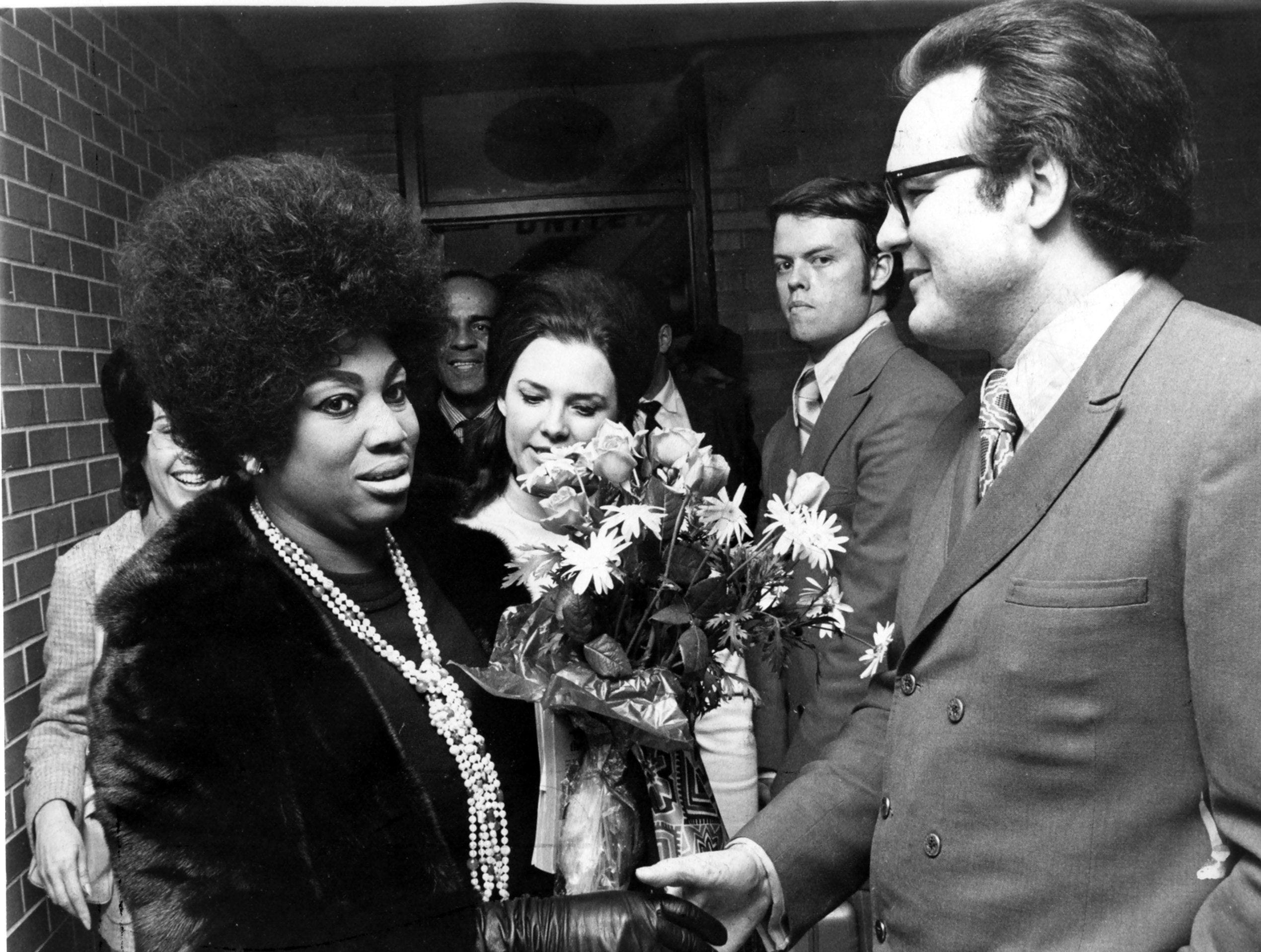Metropolitan Opera star Leontyne Price is greeted by Mr. & Mrs. George Osborne upon her arrival at Memphis International Airport on 13 Jan 1971. Miss Price's performance at the Auditorium Music Hall is co-sponsored by Arts Appreciation and Memphis State University Opera Theater.
