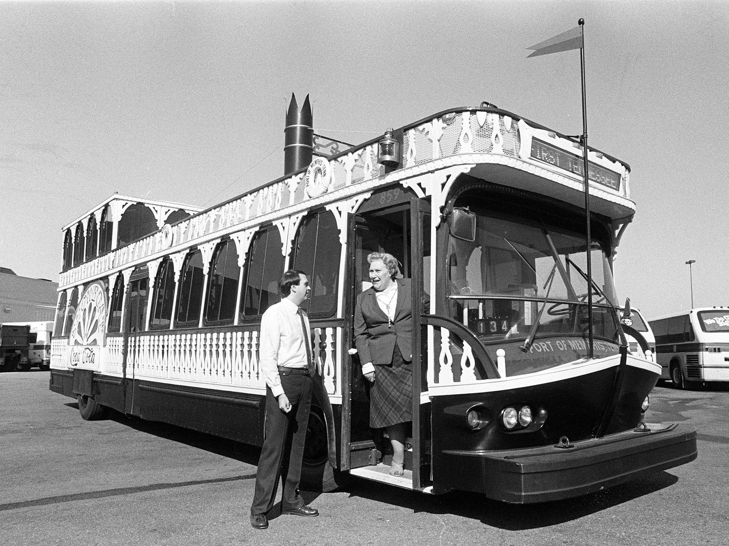 "Lawson Albritton, executive assistant to the Memphis Area Transit Authority's general manager, and Mrs. May Taylor, president of the Cooper-Young Community Association, take a look at one of the city's new Showboat buses in October 1982.  The city has received three of the buses and two are under construction.  Ten of the buses are scheduled to join the city's fleet within the next year.  Ten sponsors paid $70,000 each for renovation of the buses, which will have a ""paddlewheel"" on the side bearing the sponsor's name."