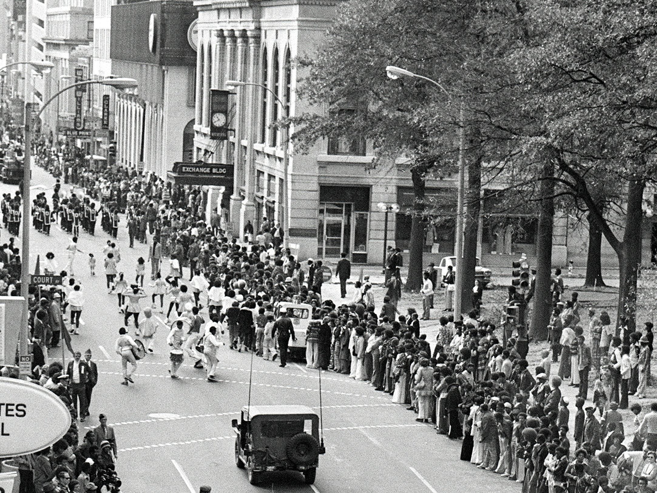 The traditional Veterans Day parade down Main Street moved one block east, to Second Street, on 11 Nov 1975 because of construction of the Mid-America Mall on Main. School bands, ROTC units and national Guard tracked artillery moved down Second from Exchange to Beale, taking two hours to pass the reviewing stand. One guard vehicle on its way to the parade pulverized 611 raised pavement markers on North Parkway between Watkins and Thomas, city officials said. Frank Palumbo, city engineer and public works director, said it will cost about $4,000 to replace the ceramic and plastic markers.