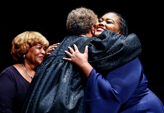 Tami Sawyer (right) hugs Judge Loyce Lambert Ryan after being sworn in as a Shelby county commissioner during a ceremony on Aug. 27 in Memphis.
