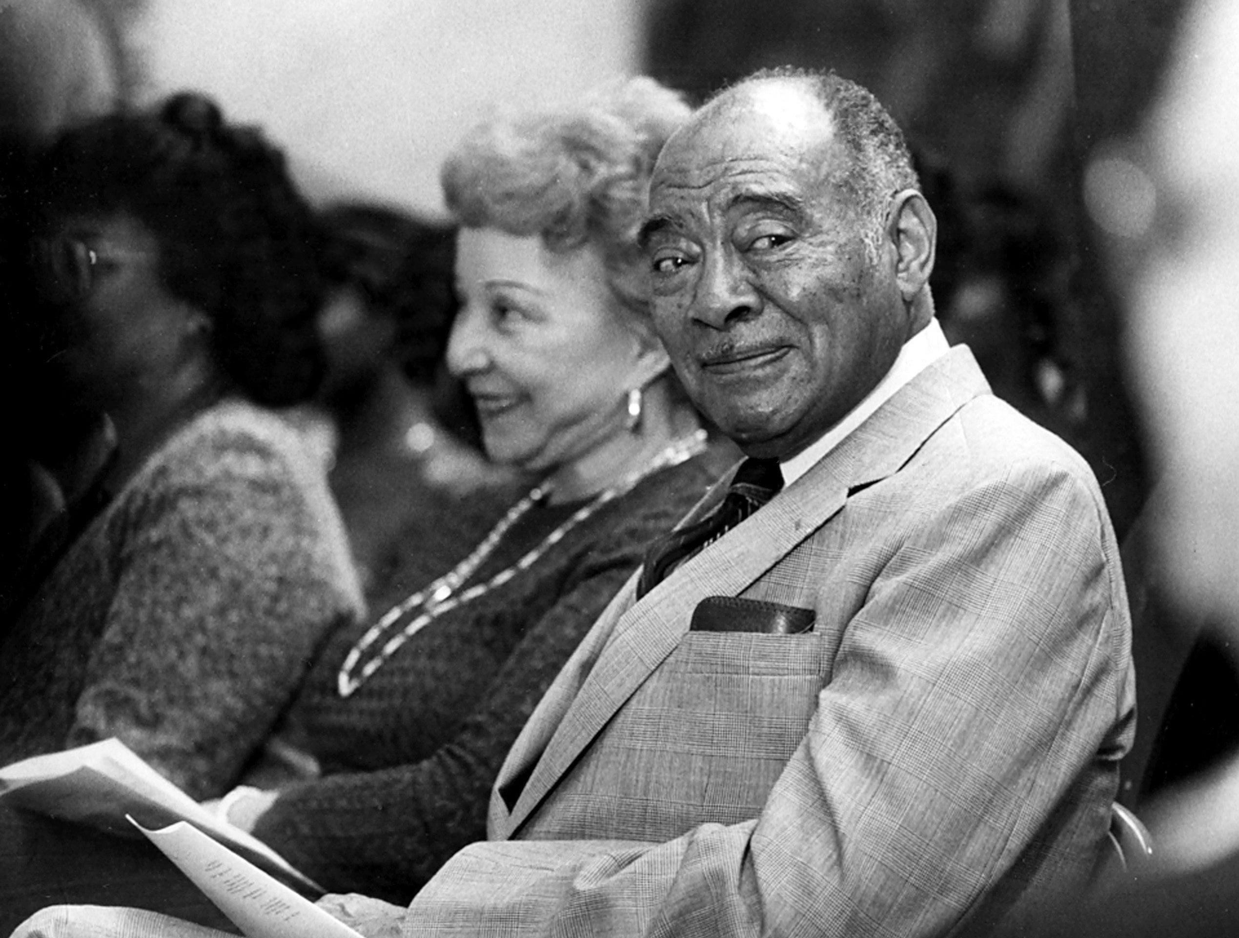 "A. Maceo Walker, chairman of Universal Life Insurance Co., listens to songs, poetry and narration about his contributions to the civil rights movement and the arts. He was honored with a program on 6 Mar 1983 at Memphis Brooks Museum of Art. ""I feel so humble to have received all of these accolades,"" Walker said. ""I have never perceived myself as being great."""