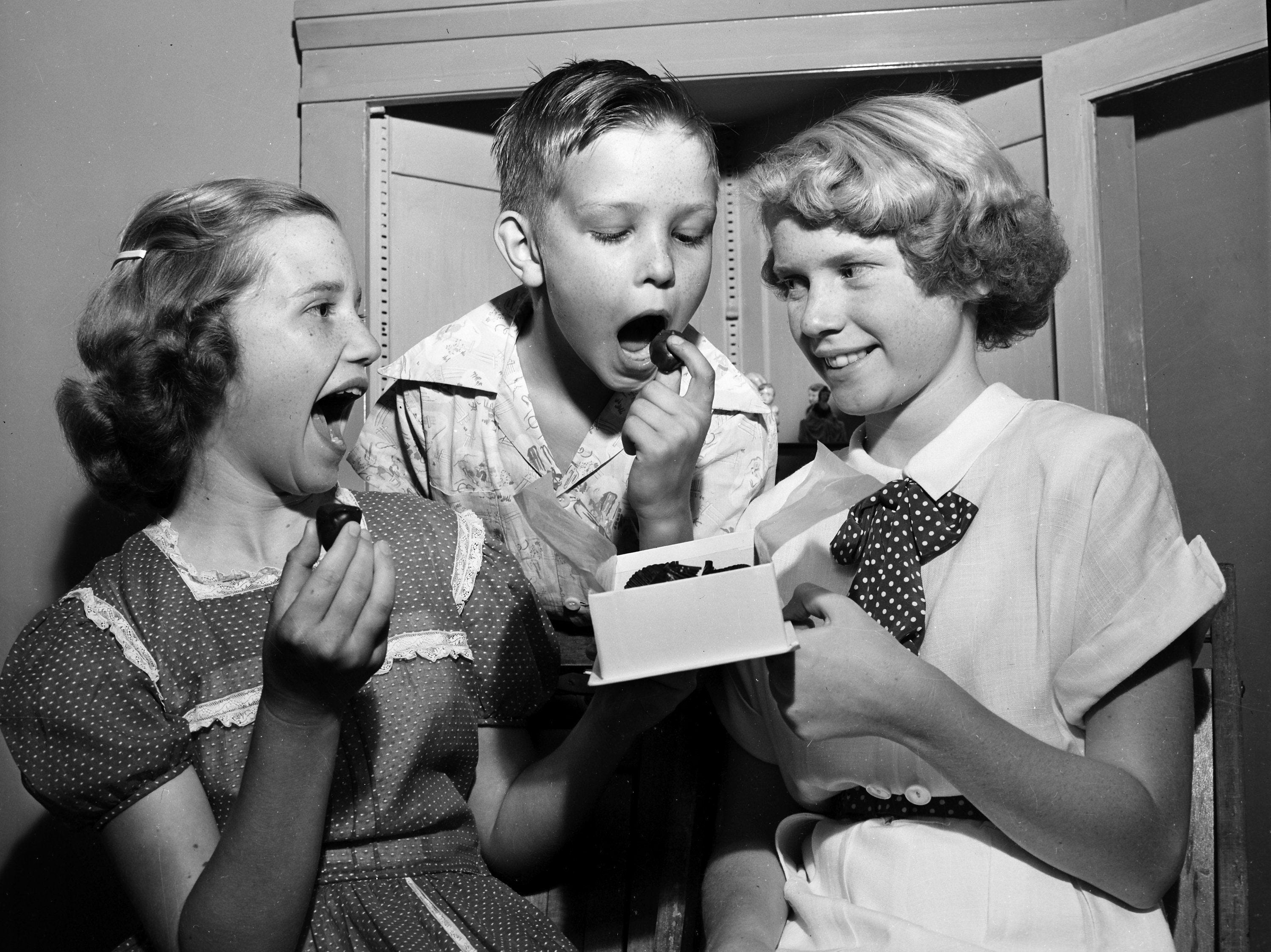 Among those exhibiting hobbies at Captain Jerry?s Hobby Show in June 1951 are these three hobbyists, who took time out to sample a box of candy. They are, from left, Bobbie Nell Speck, 13, of Capleville, Paul T. Richter, 9, of 982 Rozelle, and Frances Andrews, 11, of 760 Cypress.