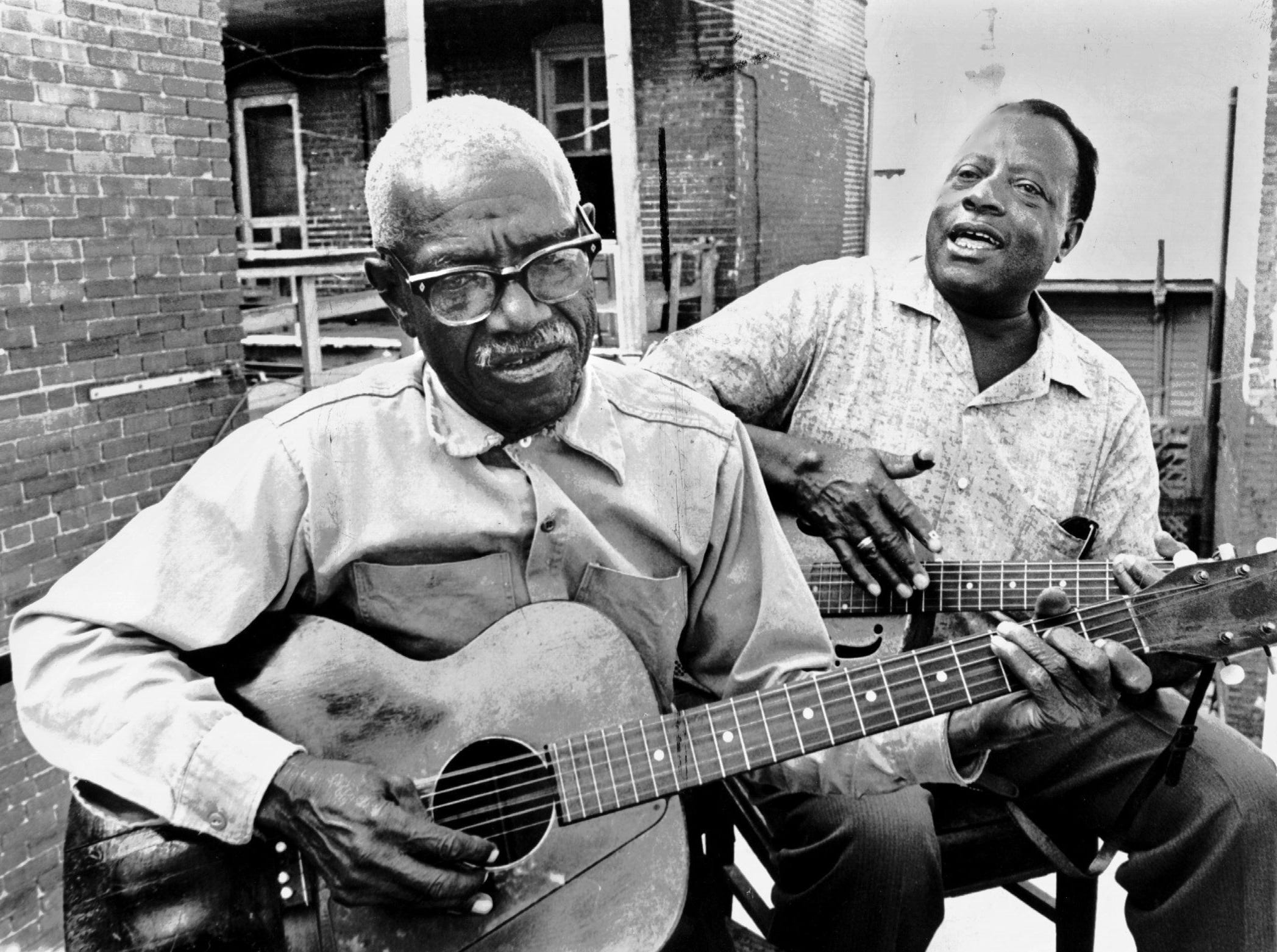 Furry Lewis and Bukka (Booker T. Washington) White perform in May 1967.  Lewis, considered by many to be the quintessential Beale Street bluesman, was ?rediscovered? by the national blues-folk revival in the 1960s. He was featured as an opening act at the Rolling Stones 1975 appearance at the Liberty Bowl. Bukka White first recorded in 1930 for Victor. He died Feb. 26, 1977.
