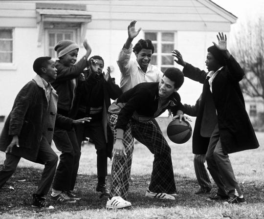 Memphis State University basketball star Larry Finch is well guarded and well liked by the boys in his Select Street neighborhood in this photograph from January 1973.