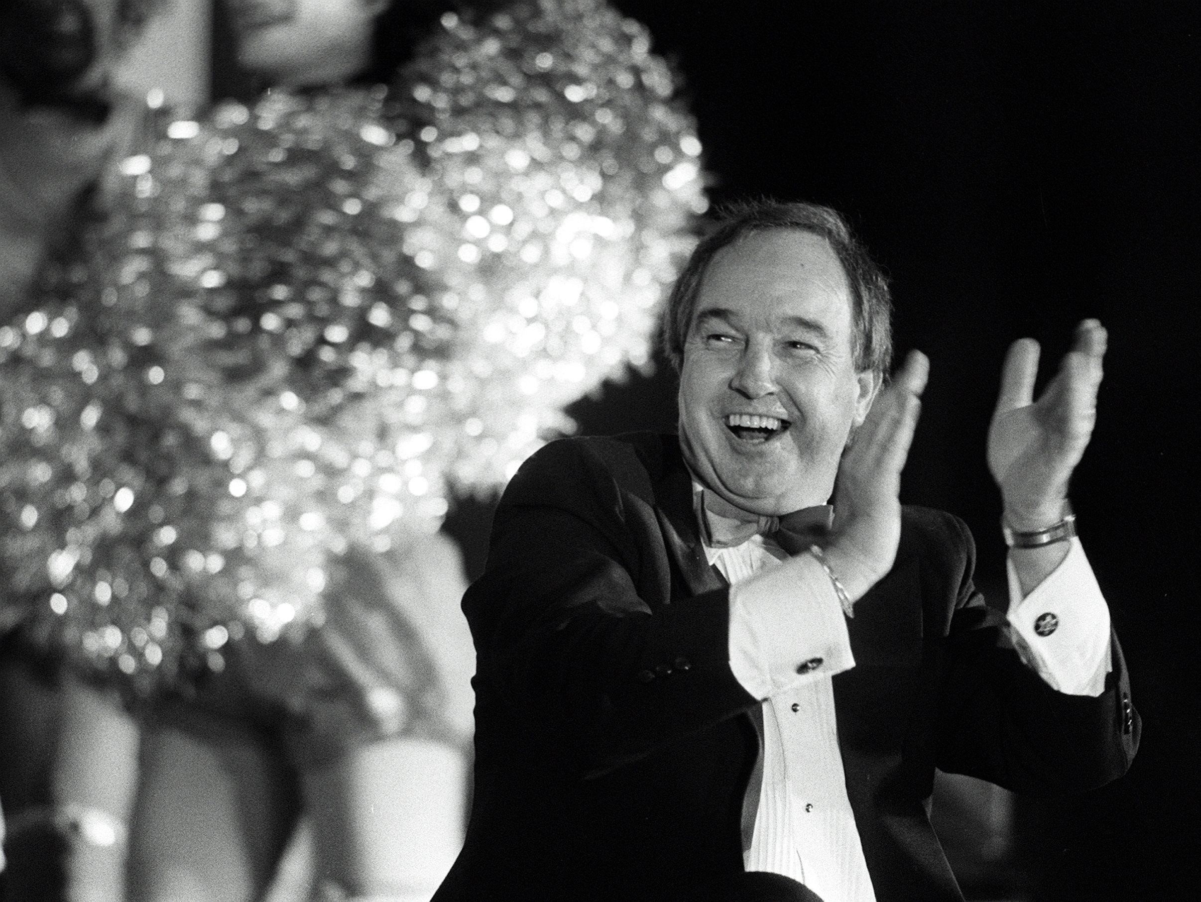 Memphis Showboats coach Pepper Rodgers shares in the laughter during a roast, where he was the object of attention, at The Peabody on 26 July 1984. Among those taking their turn at the coach were Avron Fogelman, John Grisanti and Showboats quarterback Walter Lewis. Proceeds from the event went to the Big Brothers/Big Sisters of Greater Memphis.