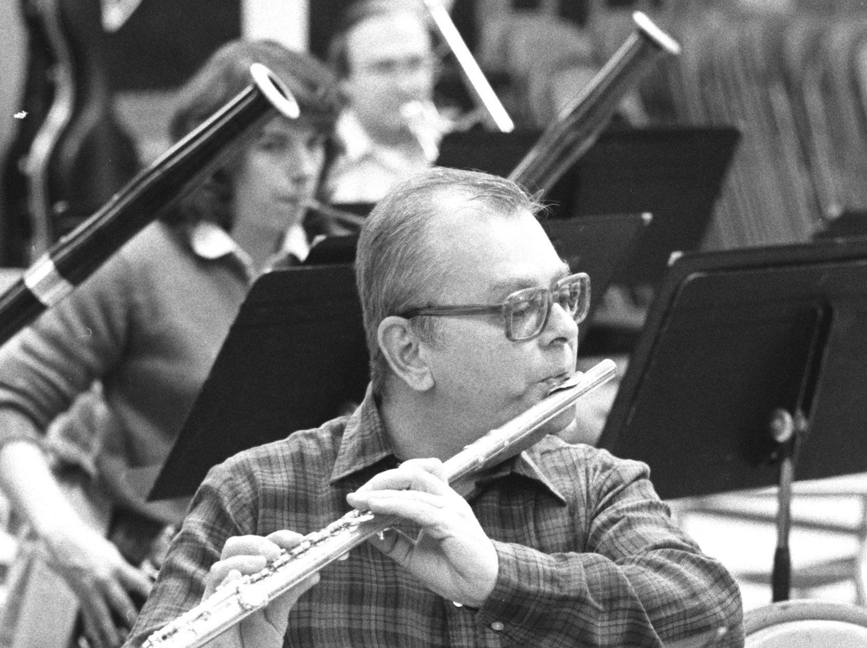 Rev. Jean Pierre Evans, associate pastor of St. Peter Catholic Church, prepares for a benefit performance with the Germantown Symphony Orchestra on 9 Feb 1984. Proceeds from the concert will be split between the orchestra and church, which is about to enter the third phase of a continuing restoration.