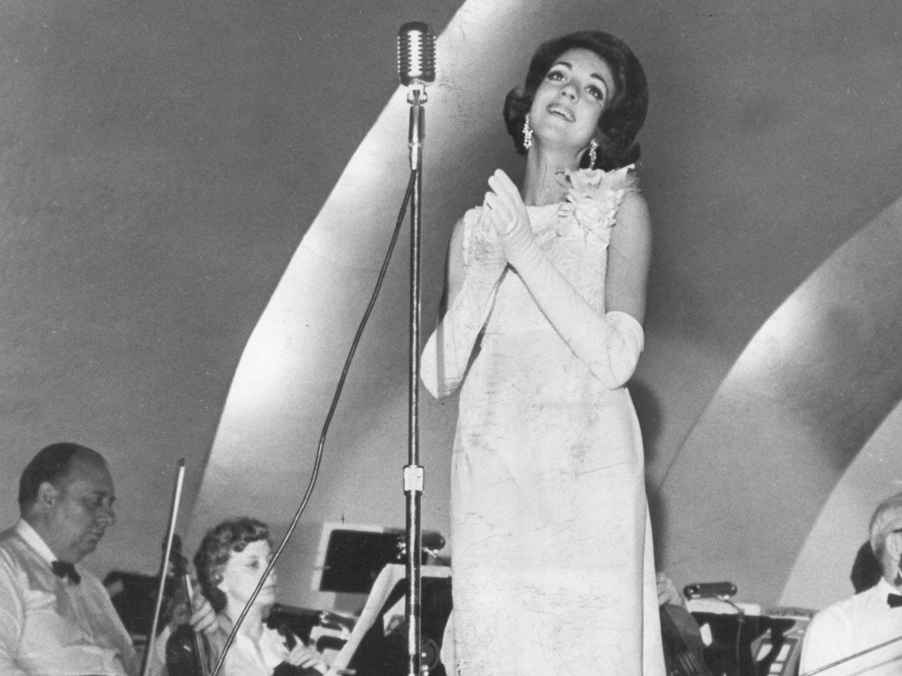 Coloratura soprano Gail Robinson received a standing ovation at the Overton Park Shell on 3 Aug 1966 and sang two encores for the crowd of 2,200 in her first genuine solo performance. The 19-year-old sophomore at Memphis State University recently returned from New York, where she trained for two months with Metropolitan Opera stars. She is one of six national winners in Metropolitan Opera auditions in New York. She was the winner of this year?s Met regional tryouts. She is the daughter of Mr. and Mrs. M.L. Robinson of 1560 Estate Drive.