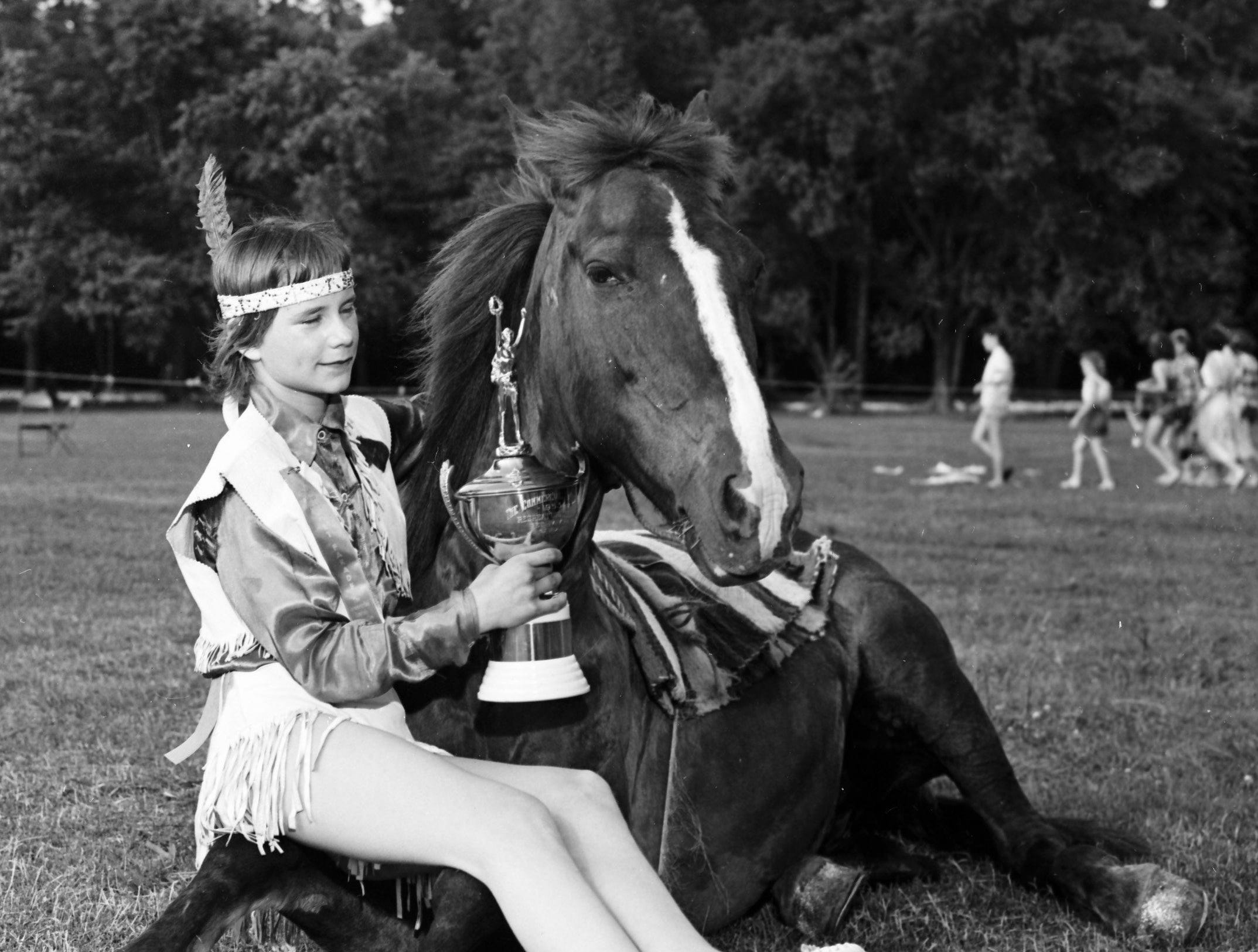 Sharleen Eastman, 13-year-old daughter of Mr. and Mrs. H.E. Eastman of the Fairgrounds, became grand winner of The Commercial Appeal-Recreation Department Pet Parade and Zoo Day celebration at Overton Park in May 1953. Her silver-hooved trick mare was judged best pet. The horse's name is not known.