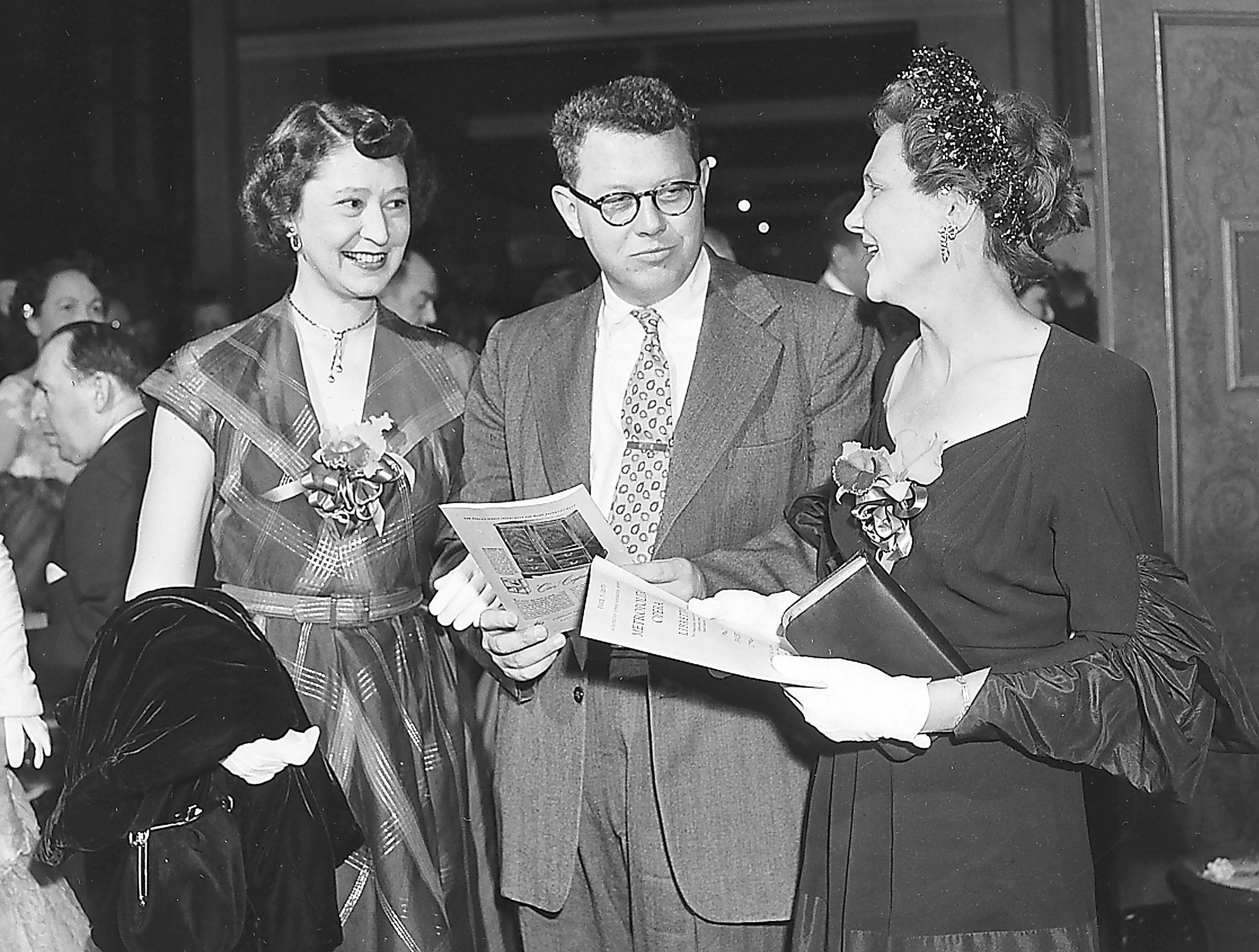 Many out-of-town visitors timed their April 1951 trips to Memphis to include the opera and among them was Mrs. Alfred F. Dantzler Jr. (Right) of Pascagoula, MS, who is the house guest of Mr. and Mrs. Walter P. Armstrong. She chats with the Armstrongs in the lobby before curtain time.
