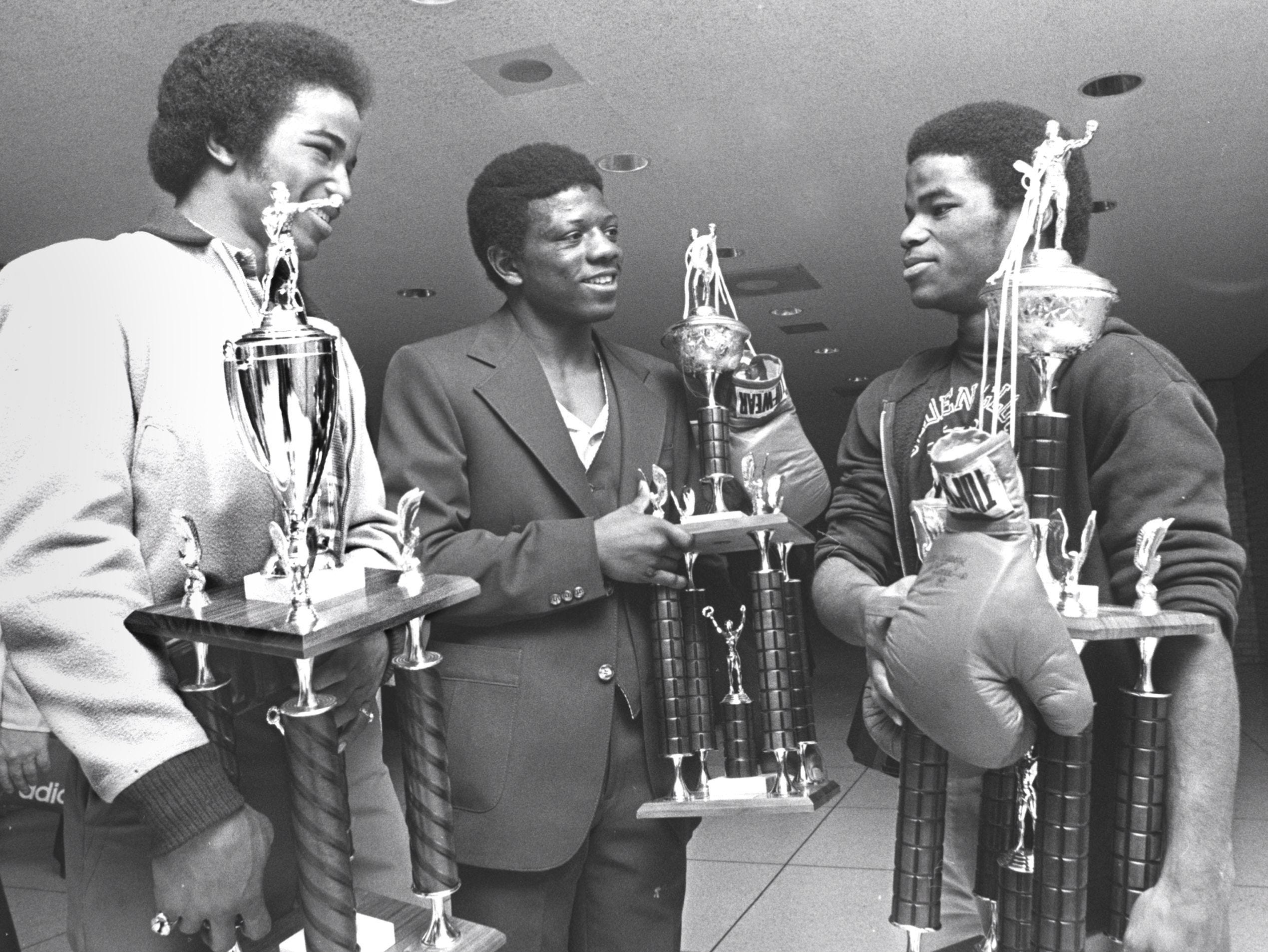 March 26, 1978 - Rickie Beard (left), Donald Bowers (center) and Jackie Beard (right) strolled through Memphis International Airport on March 26, 1978, with hardware they collected at the National Golden Gloves Tournament in Albuquerque, N.M. Bowers and Jackie Beard whipped their way through preliminary bouts and came away with national titles. Rickie Beard won a runnerup trophy. All three are from Jackson, Tenn.
