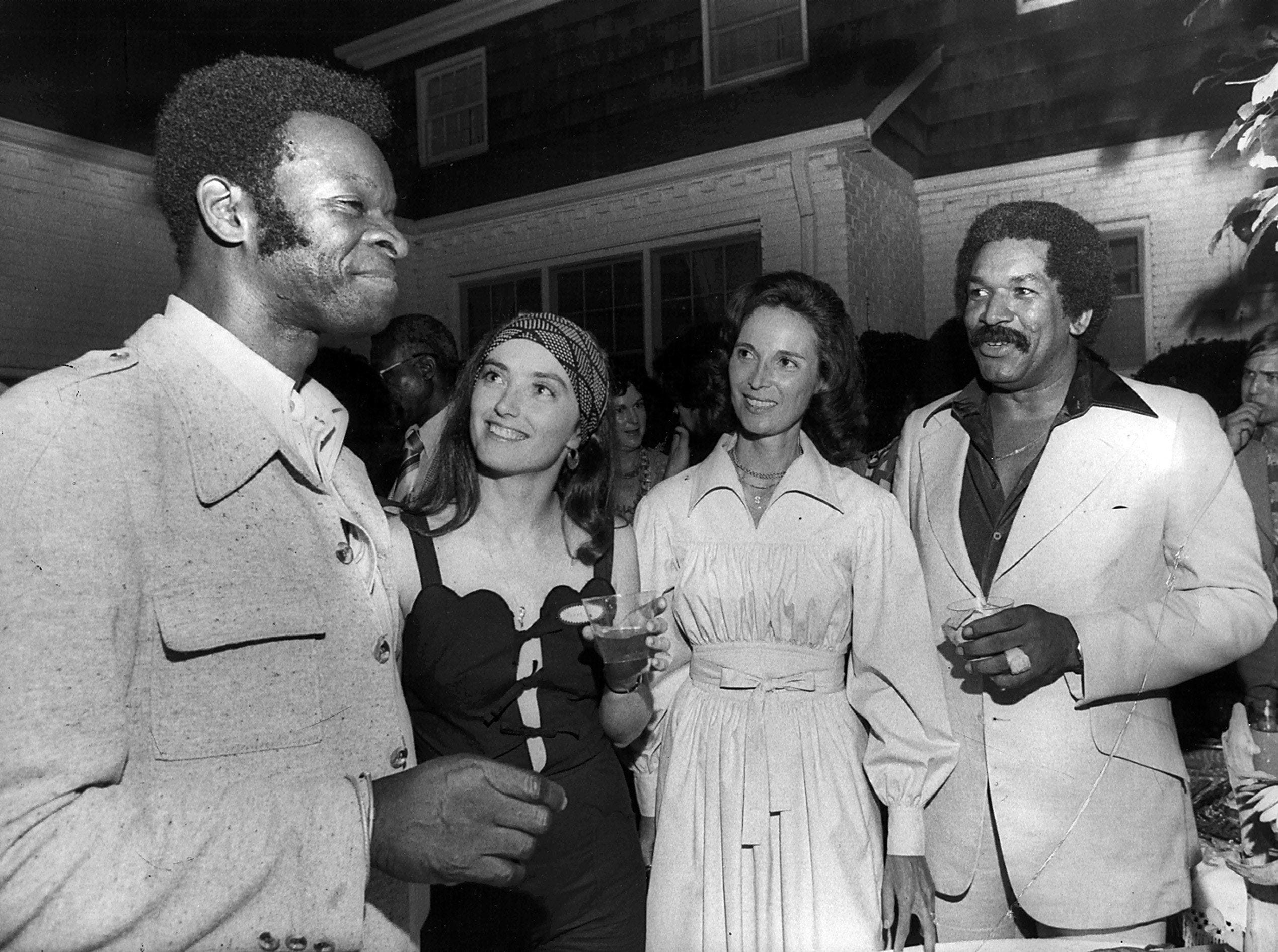 Brock Peters, (Left) co-founder and board chairman of The Dance Theatre of Harlem, was guest of honor on 30 June 1976 at a reception given by the board of directors of Ballet South.  Shown with Peters, around the pool at the home of Mr. and Mrs. L.R. Jalenak Jr. are Ballet south dancer Janet Luciano (Second Left), board member Mrs. Jerry Hanover and Larry Shaw, president of the Shaw Group of Memphis.  Peters is also an actor and recording artist.  He was scheduled to speak at the NAACP convention here the following day.