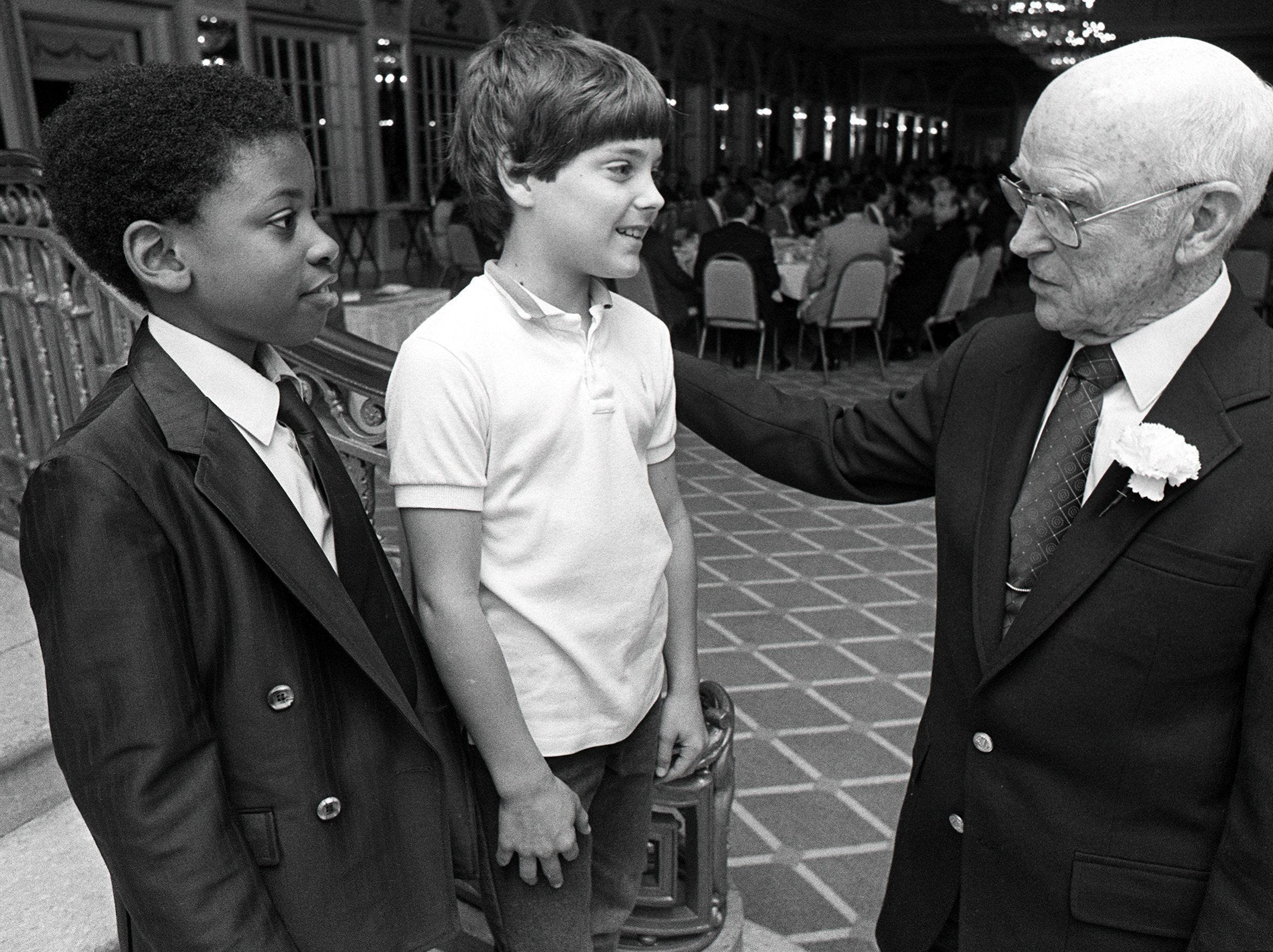 Joseph Cunningham, 10, and Trip Leonard, 13, meet with John Cleghorn, retired Holiday Inns executive, at the Man For boy luncheon at The Peabody in May 1984.  The event was the kickoff for the Man For Boys Club's fund-raising program to send needy boys to summer camp.  Cleghorn was the guest speaker at the event sponsored by the Kiwanis Club and The Commercial Appeal.  100 boys are expected to attend the 1984 camp, which begins June 14 in the Ozark Mountain foothills near Hardy, AR.