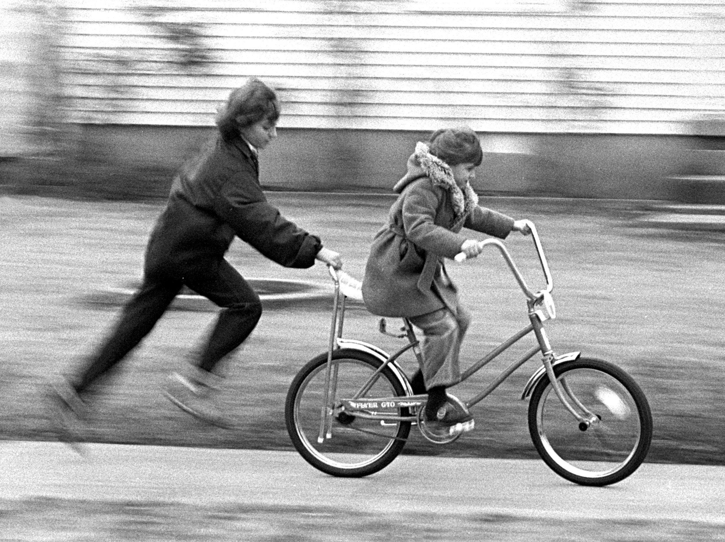 Almost as quickly as children find what Santa?s left behind, they head outside to give the new toys a try. The cool, cloudy weather doesn?t seem to matter as Vickie Turner, 11, helps her sister Rachael, 6, ride her new bicycle on Dec. 25, 1979. Vickie and Rachael are the daughters of Mr. and Mrs. William Turner of 991 Maria. Robb Mitchell / The Commercial Appeal Almost as quickly as children find what Santa's left behind, they head outside to give the new toys a try. The cool, cloudy weather doesn't seem to matter as Vickie Turner, 11, helps her sister Rachael, 6, ride her new bicycle on 25 Dec 1979. Vickie and Rachael are the daughters of Mr. and Mrs. William Turner of 991 Maria.