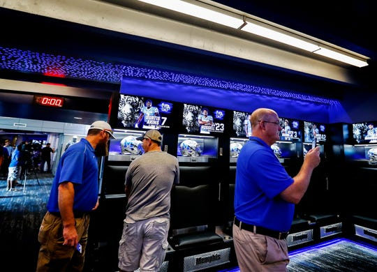 Memphis Tigers fans get a sneak peek inside the football team's new looker room at The Liberty Bowl Memorial Stadium Friday afternoon.