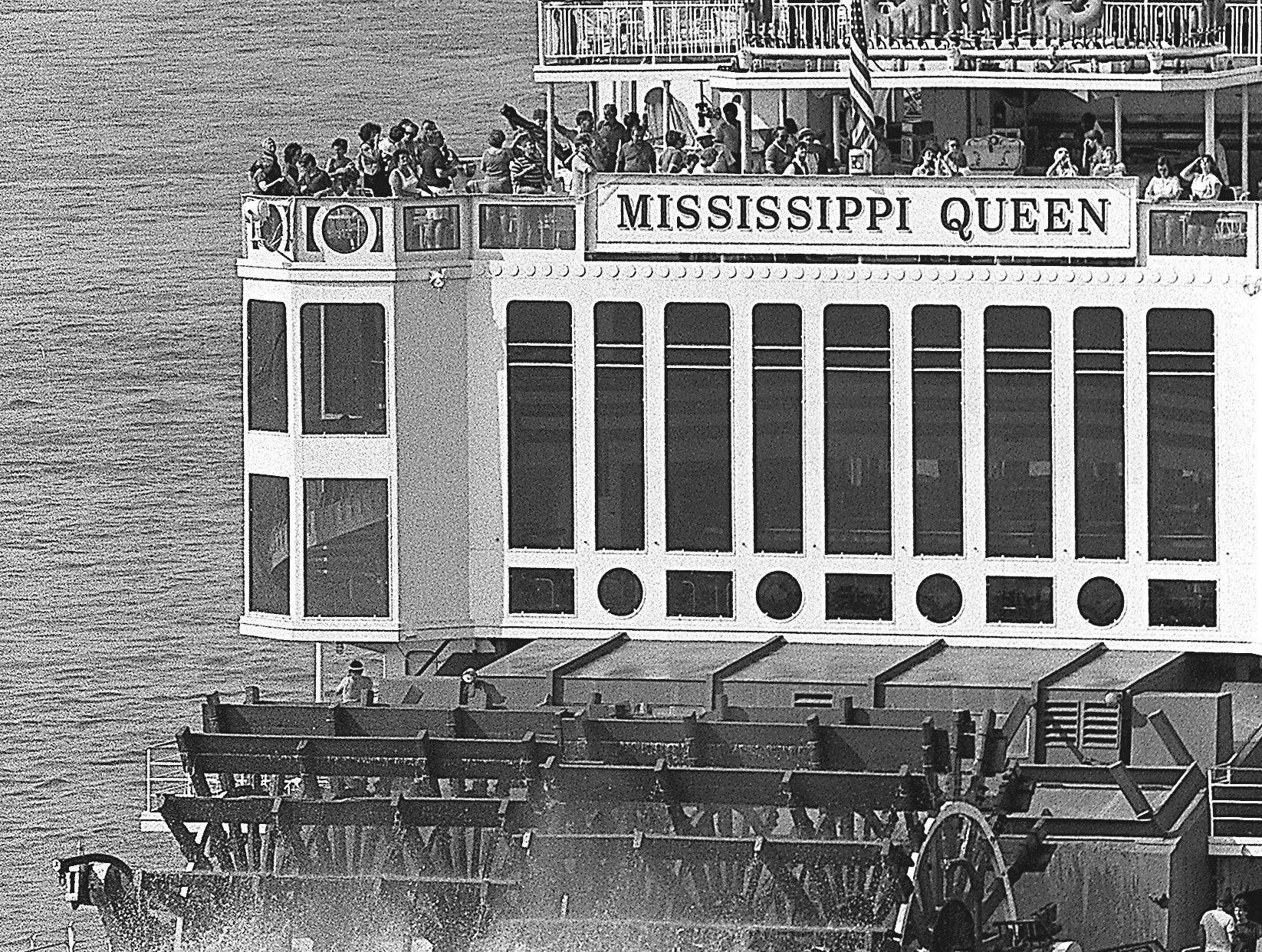 The Mississippi Queen races off toward St. Louis on 30 June 1984 after making one of its frequent visits to the Bluff City. It and the Delta Queen are taking part in the sixth annual Great Steamboat Race from New Orleans to St. Louis. The Delta Queen won last year's race, which itself is a re-enactment of the historic first steamboat race in 1870 between the Natchez and the Robert E. Lee, which won that first race. The two Queens are scheduled to arrive in St. Louis on July 4.