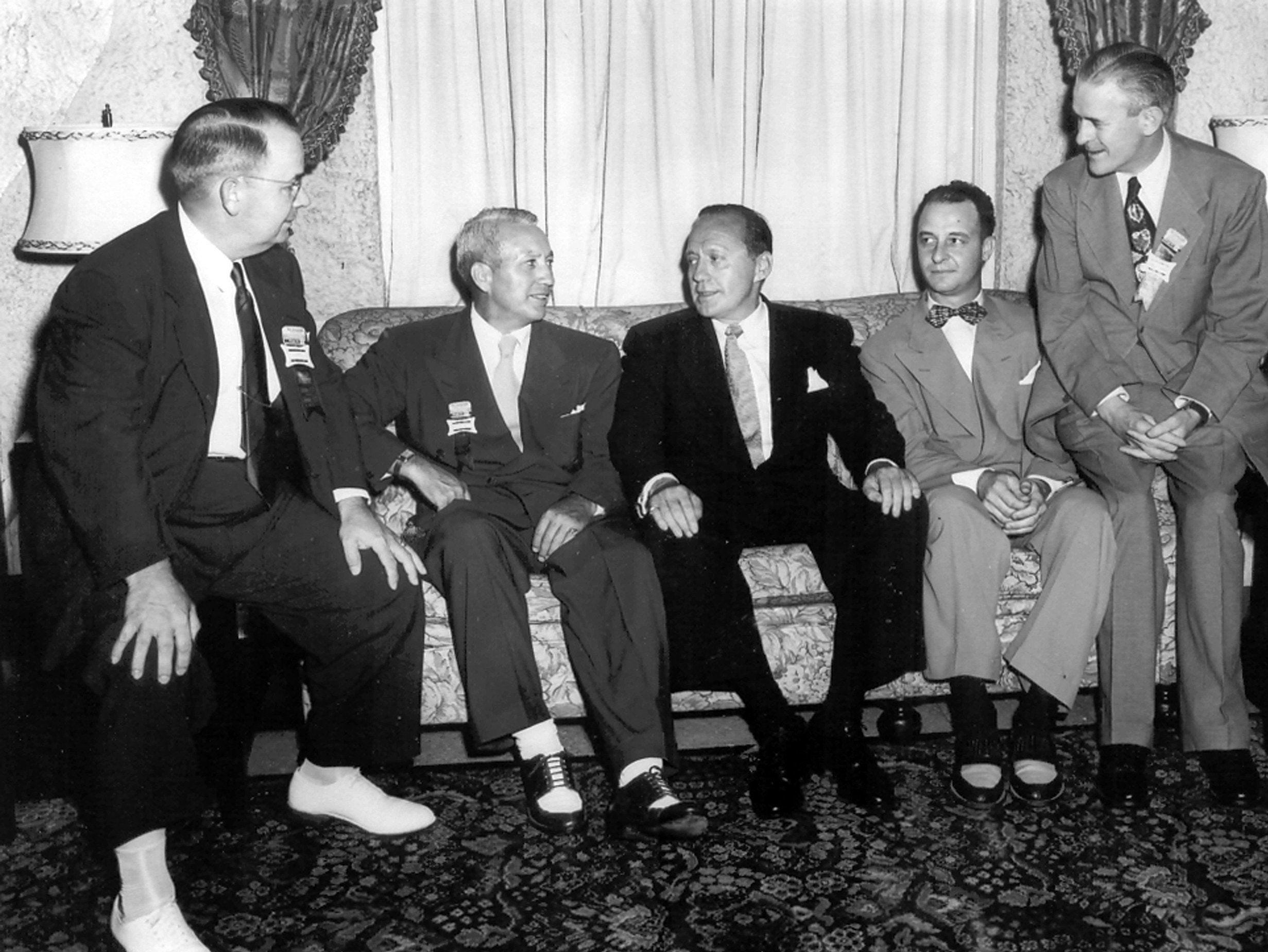 Comedian Jack Benny, center, visits with executives of Plough, Inc. on June 23, 1951. Lanny Smith is at left and F.J. ?Sonny? Condon is at right. The other two men are unidentified. Benny was in town for the grand opening of Plough?s new offices at 3022 Jackson Ave.and to perform at a benefit for service men and veterans. Benny laughed Memphians out of approximately $28,000 at Ellis Auditorium before taking his troupe to Korea to entertain service men the following week. Benefits from the sale of tickets to the show were to be divided among Veterans Hospital 88 and Kennedy Veterans Hospital, the Memphis Auxiliary of Navy Relief and the Memphis Mothers? Canteen.