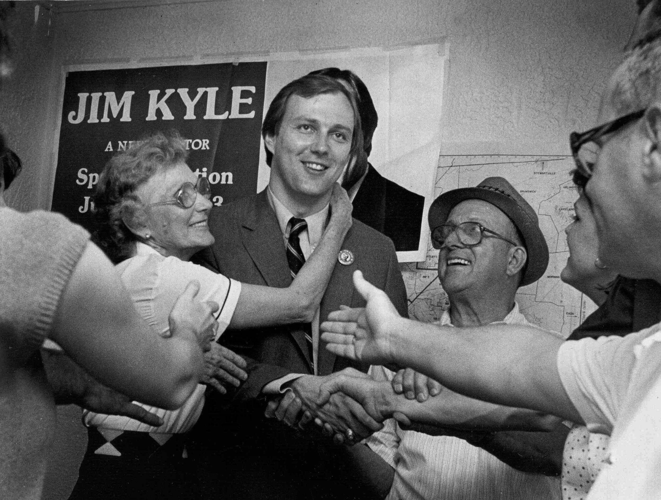 Jim Kyle celebrates his election to the State Senate from District 28 with his parents Louise and Jimmy Kyle and other well wishers on 10 June 1983.