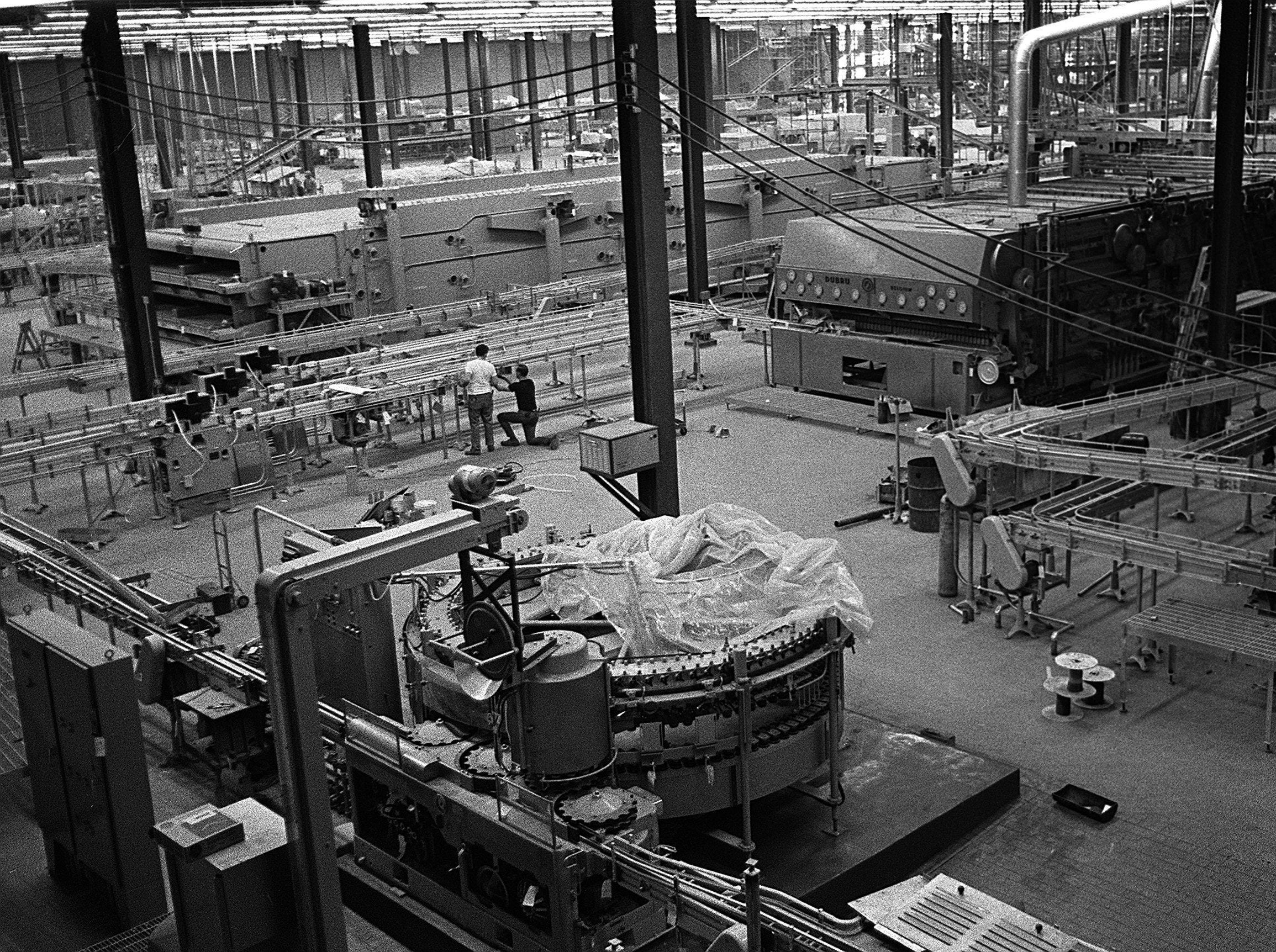 Workers are in the final stages of construction at the Joseph Schlitz Brewing Co. plant at 5151 Raines Road in mid-April 1971.  Work at the 40-acre site will end and beer making will begin soon, according to plant manager John Stevens.  Each bottle production line will fill, label and cap 850 bottles per minute when the plant is completed.