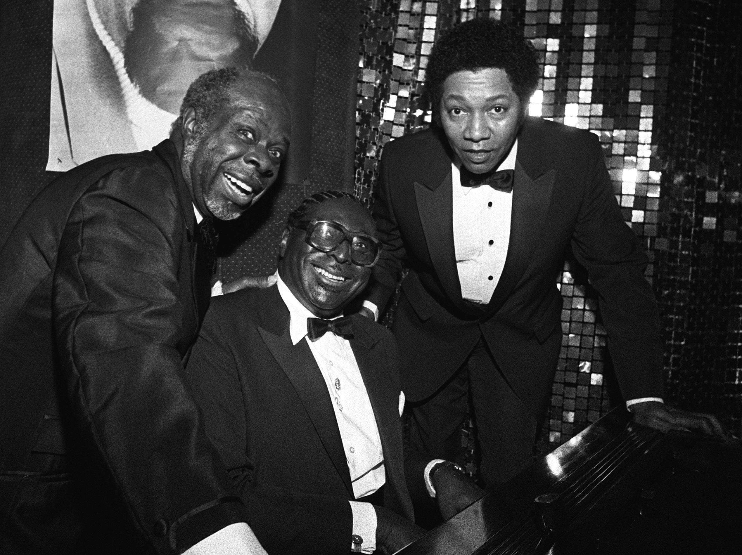 Rufus Thomas, Albert King and Luther Ingram (From Left) shared a musical moment at The Peabody's Skyway in April 1984 where artists from the Stax recording company got together for a reunion dinner. The black tie dinner was a prelude to a reunion concert at the Mid-South Coliseum, with more than 15 former Stax artists invited to perform.