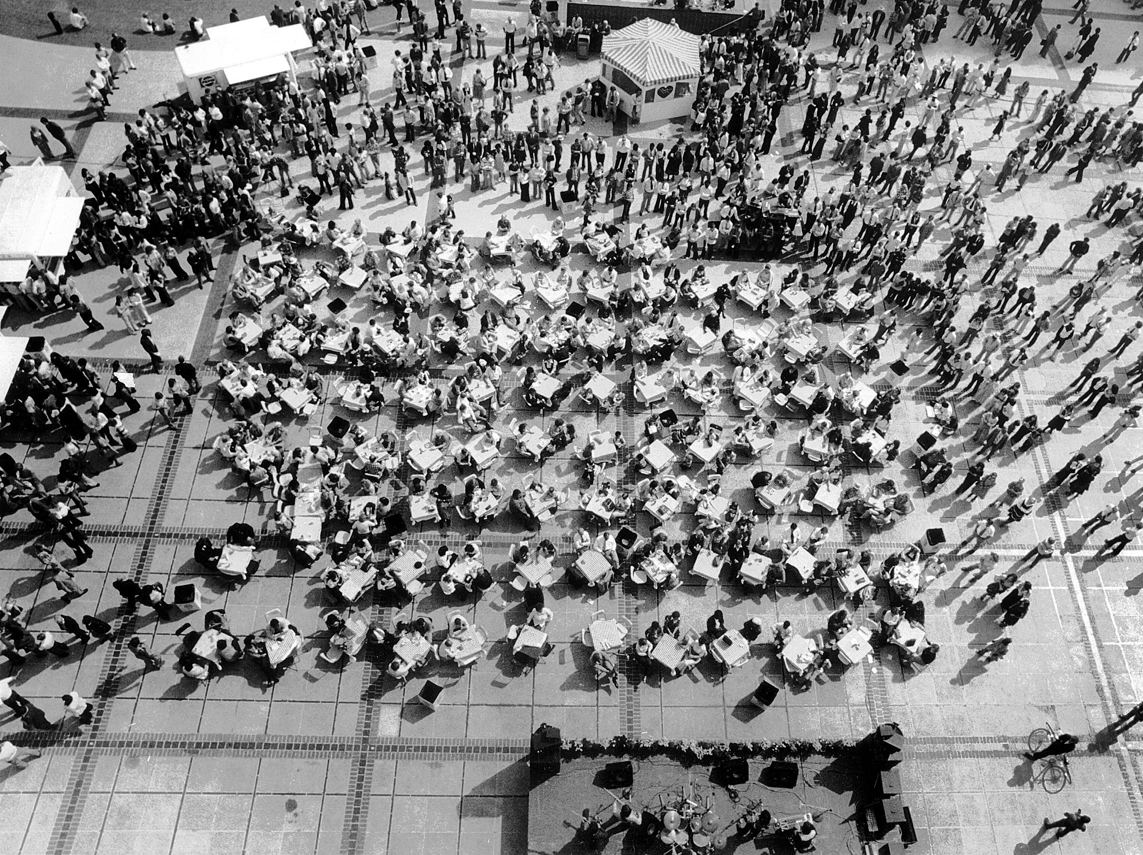 """October 10, 1978 - """"Shylo"""" (on stage at bottom of photo) entertains the lunch time crowd at Oktoberfest in Civic Center Plaza as seen in this photograph taken from the roof of City Hall on October 10, 1978."""