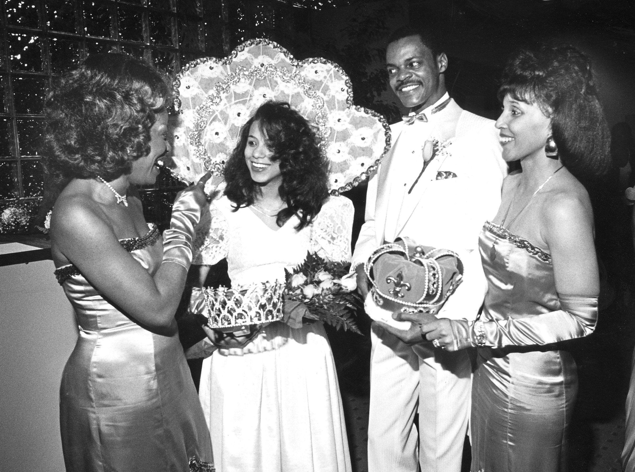Waurine Campbell (Left), 1985 Cotton Makers' Jubilee Queen talks with 1987 queen Billene Miller (Second Left) on 18 Apr 1987. 1987 King Lamon Lomax and Catherine Doggett (Right), 1984 queen look on.