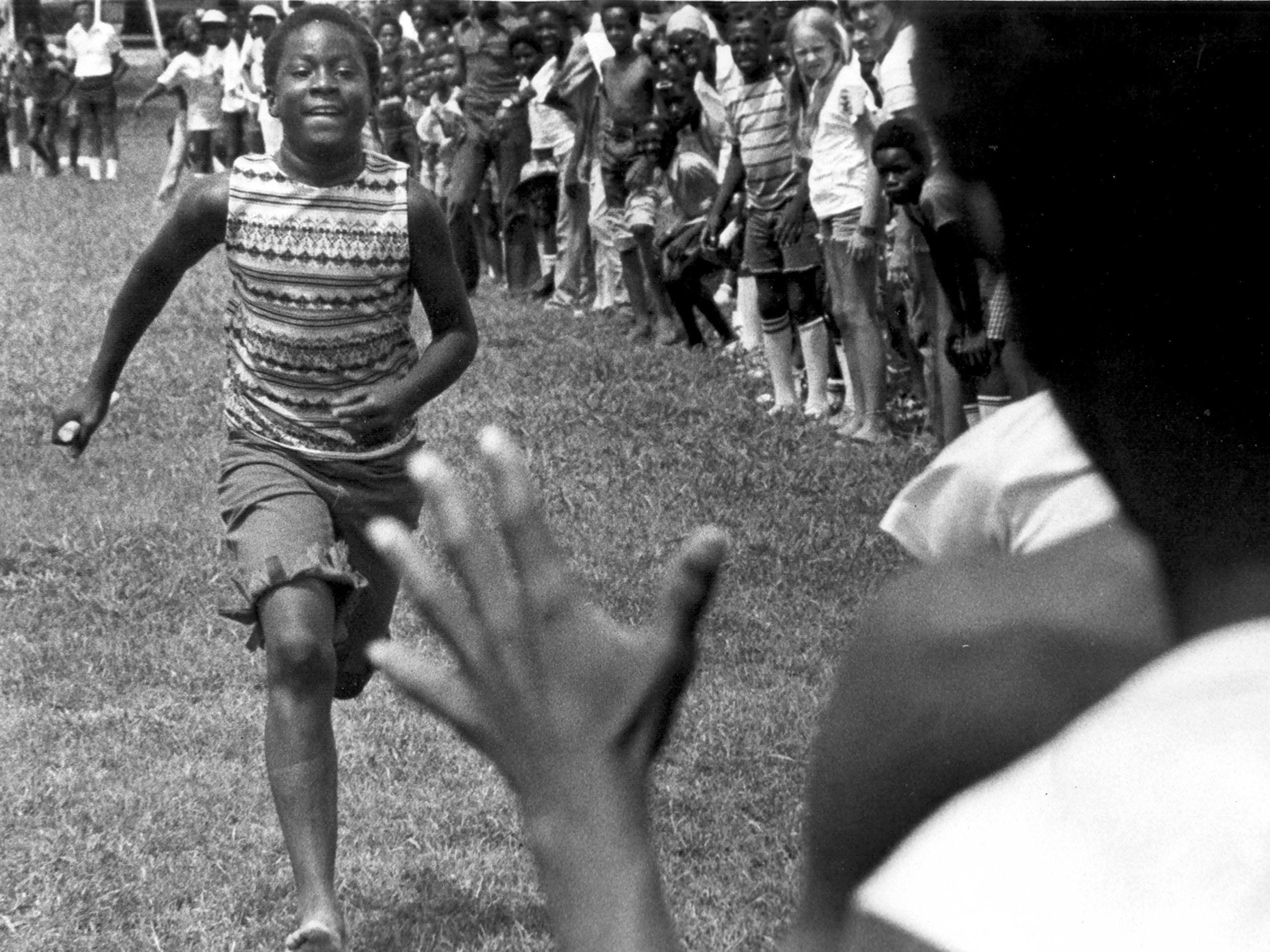 Marvel Locke,13, heads for the exchange in a relay during the Memphis Park Commission?s Zone Two track meet at Gaisman Park on 30 July 1976.