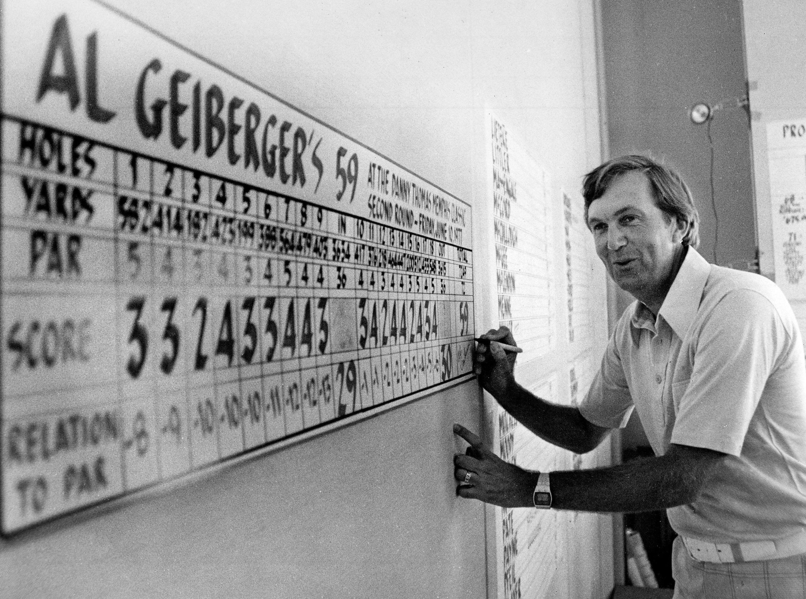 Al Geiberger signs a giant replica of his scorecard after shooting 59 during the second round of the Danny Thomas Memphis Classic at Colonial Country Club's south course on June 11, 1977. Person won the tournament in 1968 and 1969.
