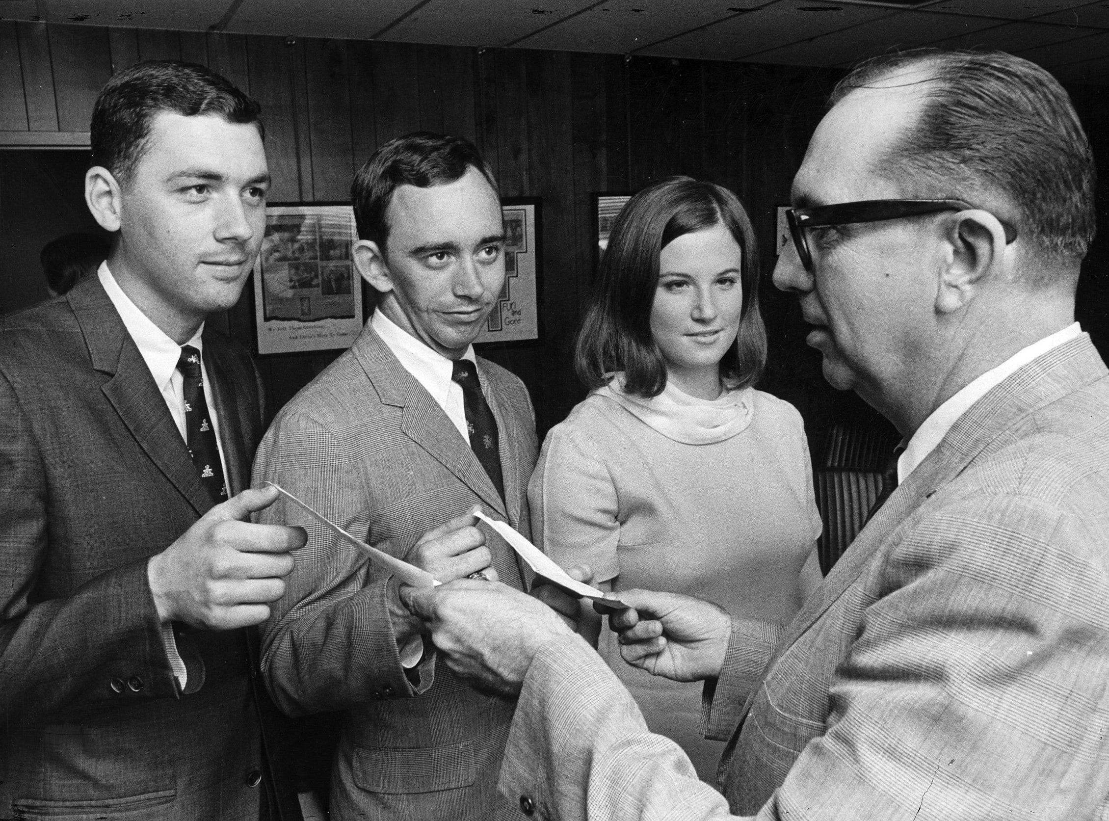 William B. Street (Right), scholarship chairman of the Memphis Press Club, presents checks to 3 of the 22 winners of awards and scholarships announced at the Gridiron Show at Holiday Hall on 29 May 1968. They are (From Left) Johnny Johnson of Natchez, MS. and Charles Overby of Jackson, MS, students at the University of Mississippi, who both won awards for journalistic excellence, and Miss Janna Pepper of Jackson, MS, who won a scholarship to Mississippi State University. The students selected for the honors attend seven colleges and universities in the Mid-South area. Last year's show provided $3,000 for scholarship awards.