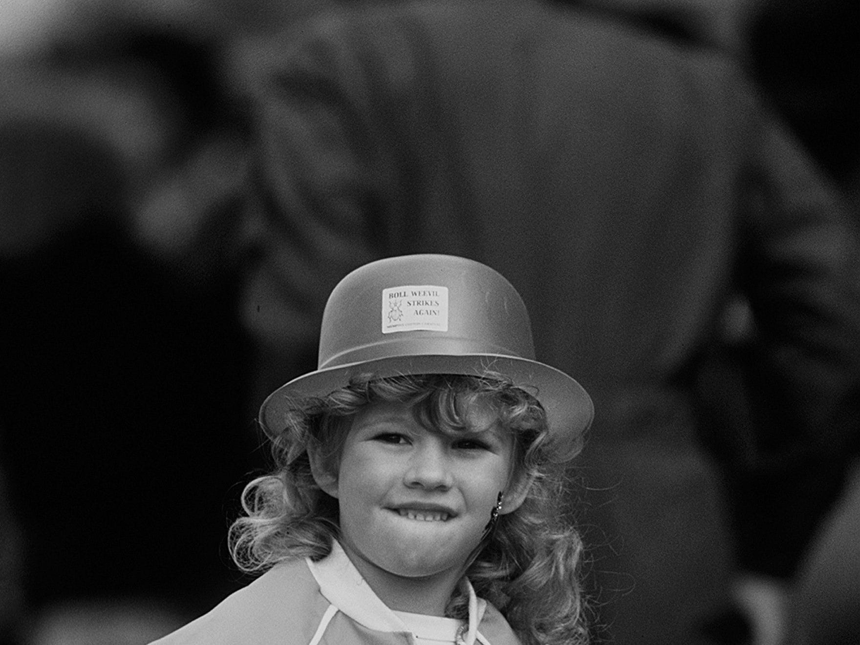 Hillary Hyden, 5, was all decked out in green as she watched St. Patrick's Day festivities on 16 Mar 1985. Police estimated the crowd watching the events on Madison Avenue at between 35,000 and 40,000.