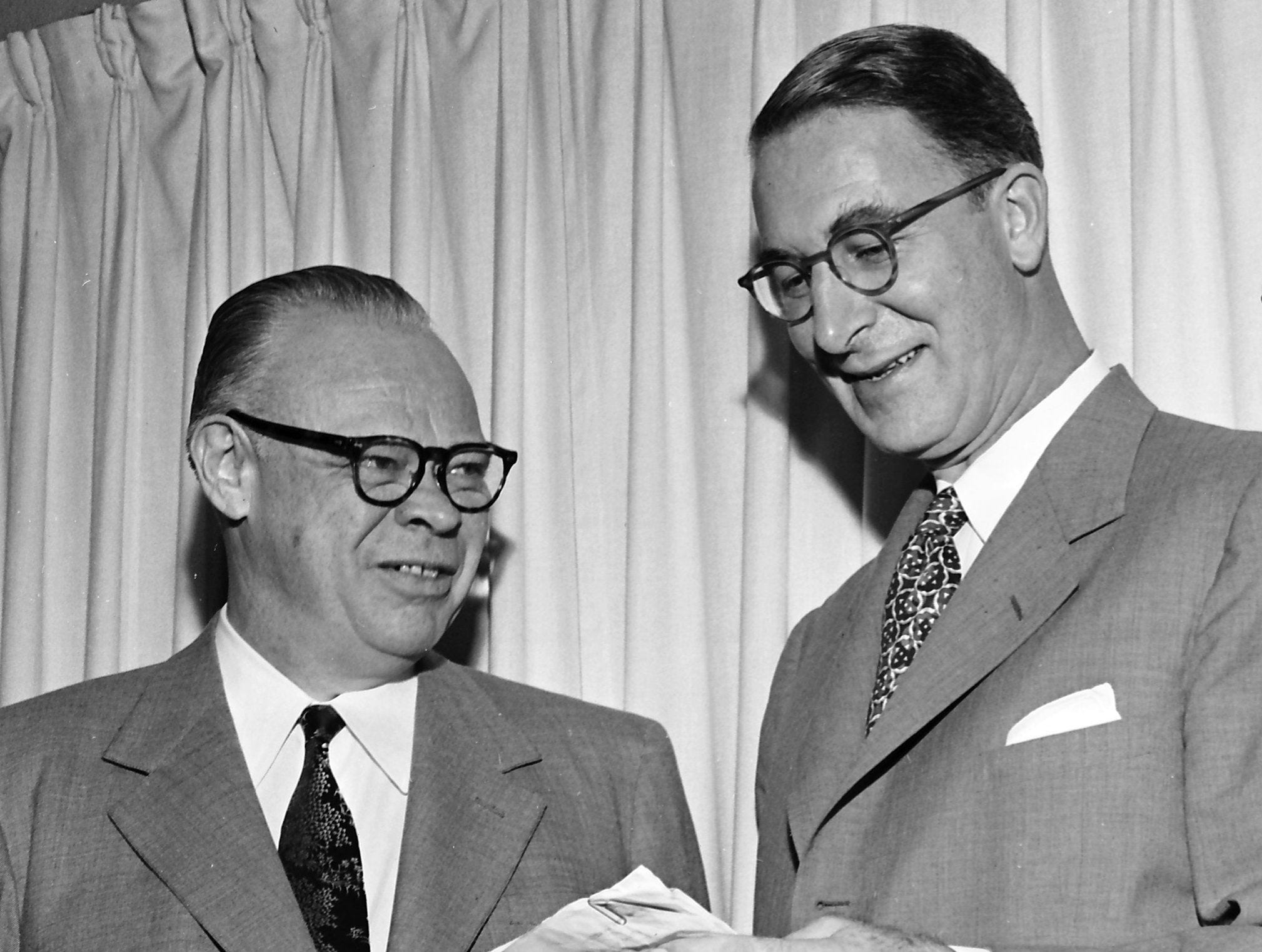The question of the accomplishments of the Eisenhower Administration brought different answers in May 1953 from Republican Representative Howard Baker, left, and Democratic Senator Estes Kefauver. The two attended the University of Tennessee together. The Tennesseans spoke at the Memphis Public Affairs Forum at the YWCA.