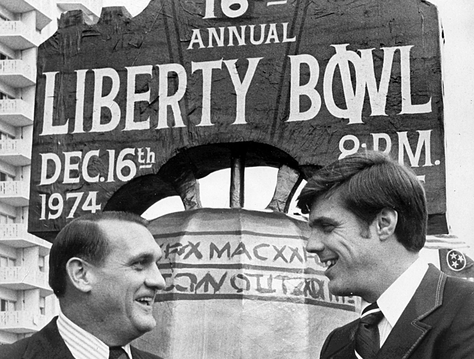 Opposing coaches Jerry Claiborne (left) of Maryland and Bill Battle of Tennessee got together after the Liberty Bowl luncheon, held at the Holiday Inn Rivermont on Dec. 16, 1974. The two teams played in the 16th edition of the postseason classic.