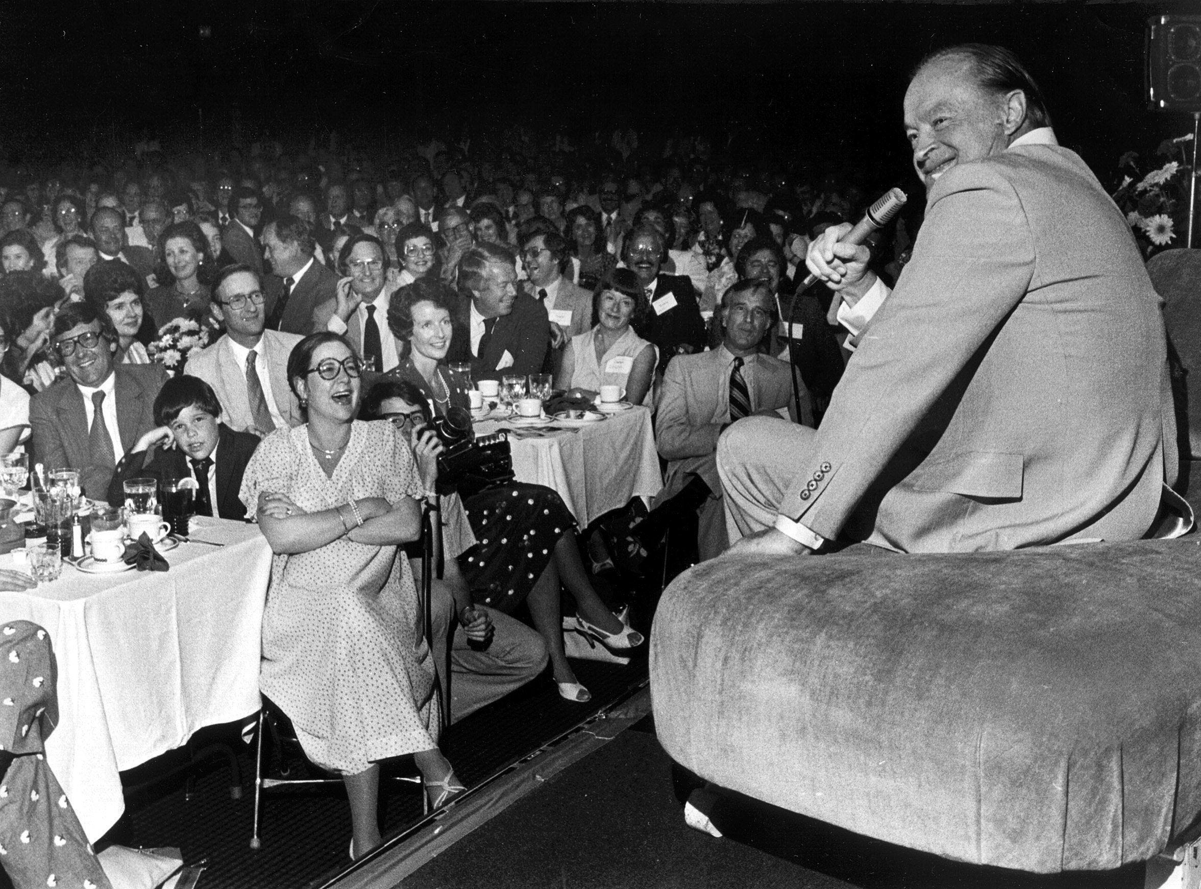 Bob Hope shares a laugh with the American Cotton Shippers Association during a performance at the Hyatt-Regency Hotel on May 11, 1979.