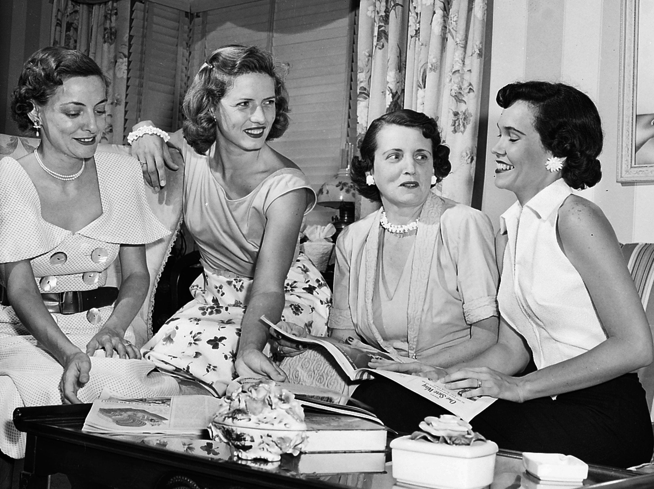 Discussing plans on 9 June 1953 for an August fashion show to be given by the Memphis Christian College Alumnae Club are new officers of the group. They are, from left, Mrs. David Cartwright Jr., president; Mrs. Blair Wright, treasurer; Mrs. Ralph Hanger, vice president; and Mrs. Fraser Humphreys Jr., parliamentarian.