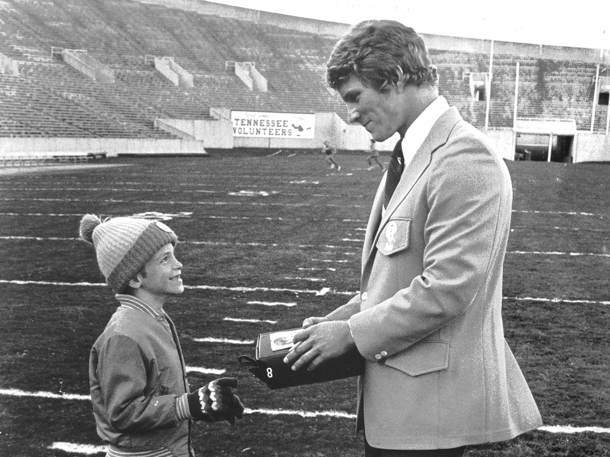Seven-year-old Bryan Donnelly, son of Mr. and Mrs. Jim Donnelly of 2579 Cedarville Drive, gets an autograph from University of Tennessee quarterback Randy Wallace at Memphis Memorial Stadium on Nov. 14, 1975. The Vols were in town to play Ole Miss the following day and the Rebels won 23 to 6 in front of 51,389. Wallace was sacked a staggering nine times. Memphis State beat Houston 14 to 7 in the second half of a day-night doubleheader.
