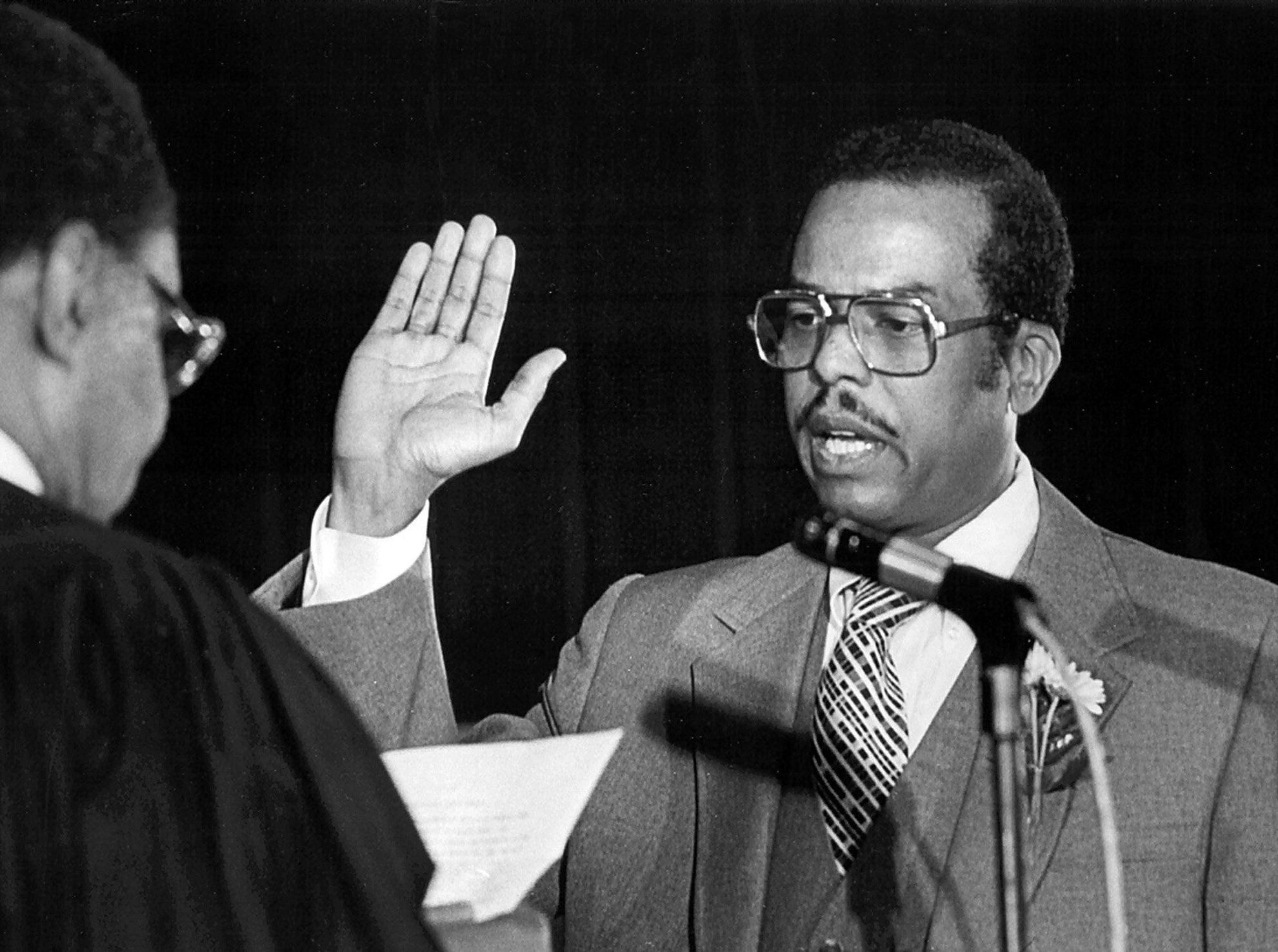 J.O. Patterson is sworn in as interim Mayor of Memphis on 1 Oct 1982, becoming the first black to occupy the city's highest office.  He was sworn in after Mayor Wyeth Chandler (Not Shown) stepped down to become a Circuit Court Judge.  Mayor Patterson is being sworn in by Criminal Court Judge H.T. Lockhard (Left).  He was flanked by his father, Bishop J. O. Patterson (Not Shown), head of the Church of God in Christ and Bishop Carroll T. Dozier (Not Shown) of the Catholic Diocese of Memphis.