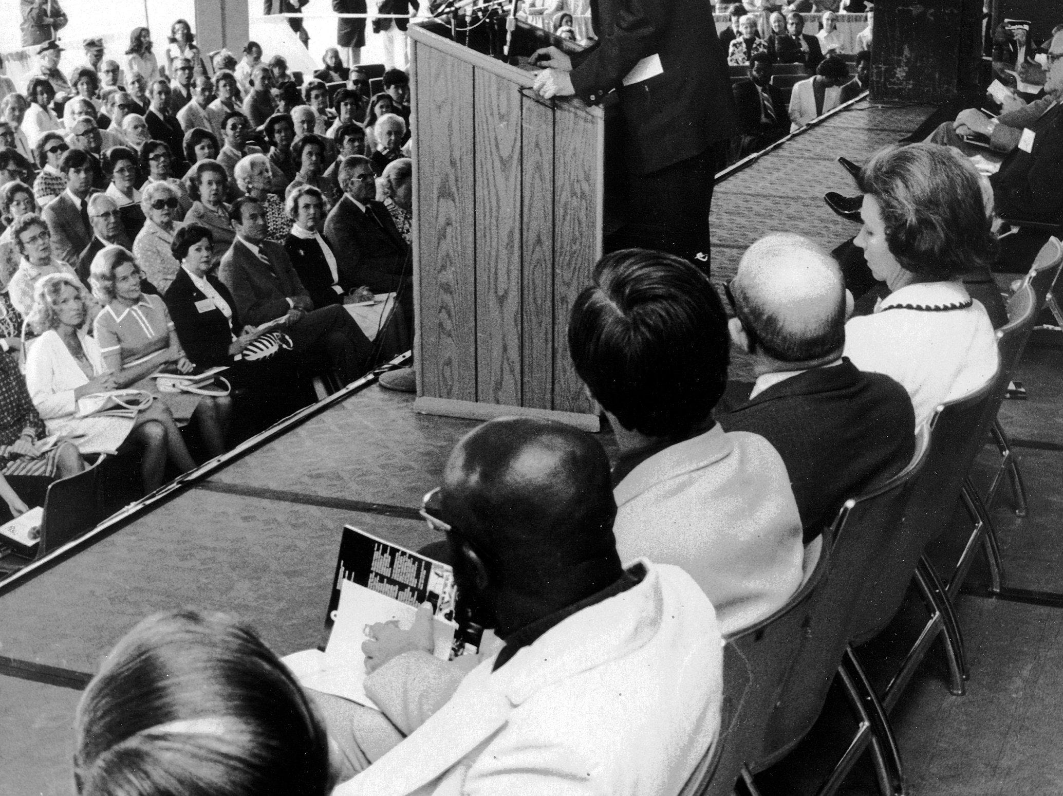 """E.W. """"Ned"""" Cook (at podium) speaks at the dedication of the Memphis Cook Convention Center on 11 May 1974. The center was named for Cook's father, Gen. Everett R. Cook."""