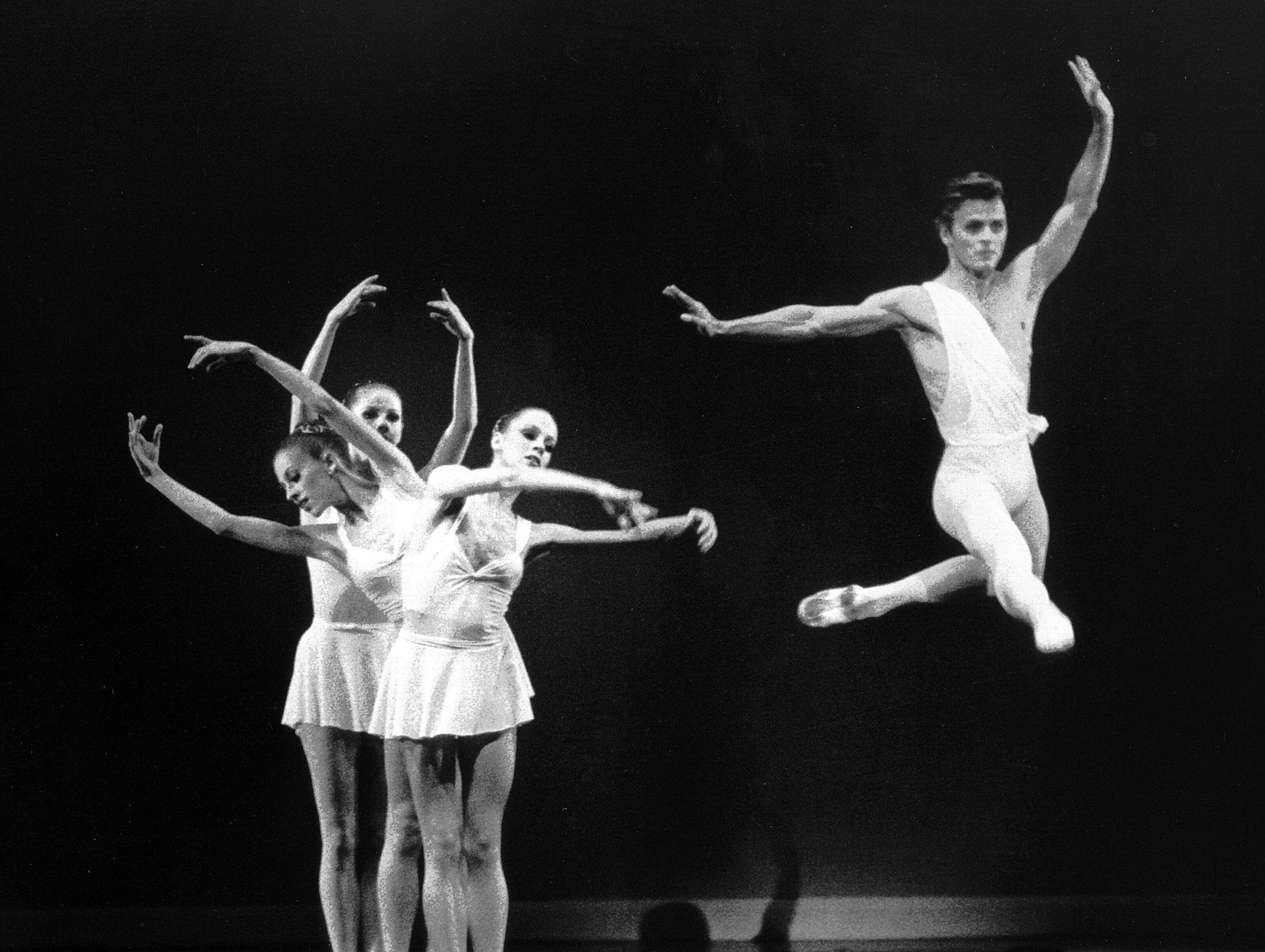 Mikhail Baryshnikov takes to the air in Ballet Company's Apollo with Heather Watts, Kyra Nichols and Judith Fugate on 30 Oct 1979.  The benefit performance at The Auditorium's Dixon-Myers Hall played to virtually a full house at the 4,361 seat venue.