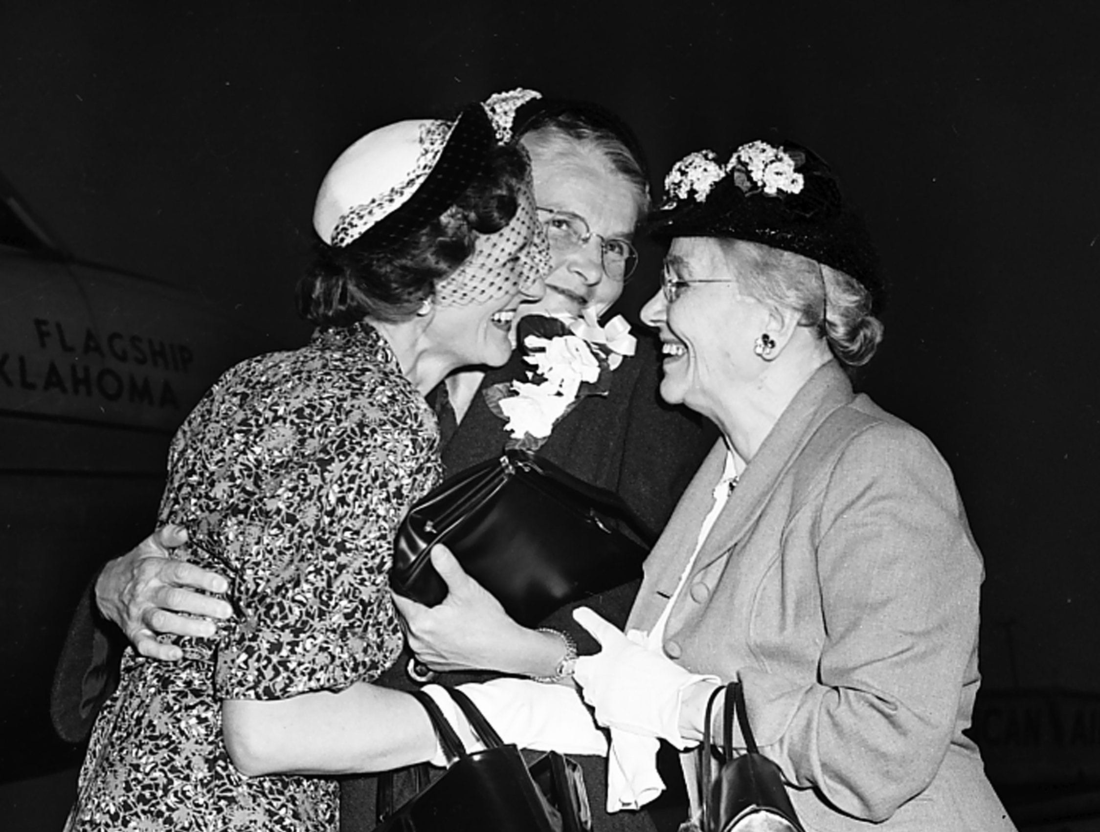 Miss Nellie A. Dyer, center, recently freed from a North Korean prison camp, is hugged by her cousin, Mrs. Mary Angus, left, and Mrs. P.H. Pierce, a longtime friend, as she stopped at Municipal Airport in May 1953. Miss Dyer, a Methodist missionary, was held by the Reds for two years and 10 months. She stopped here en route to her home in Conway, Arkansas. Mrs. Angus lives at 1311 Tutwiler and Mrs. Pierce at 1352 Carr.