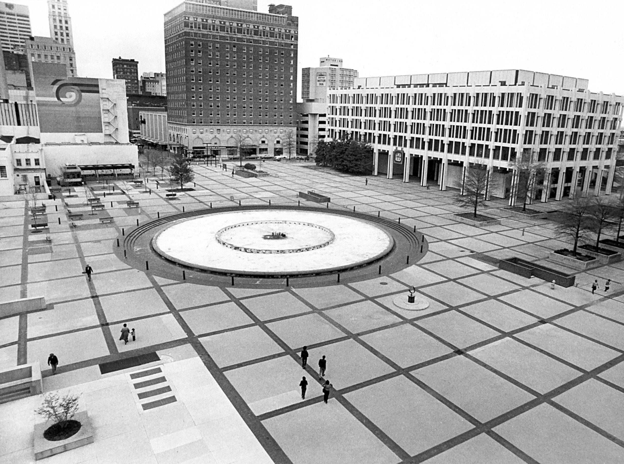 There was a fountain, but no trolley or clock tower when this image was taken of what was called Civic Center Plaza. The photograph was taken from the State of Tennessee Office Building on 25 Mar 1982.