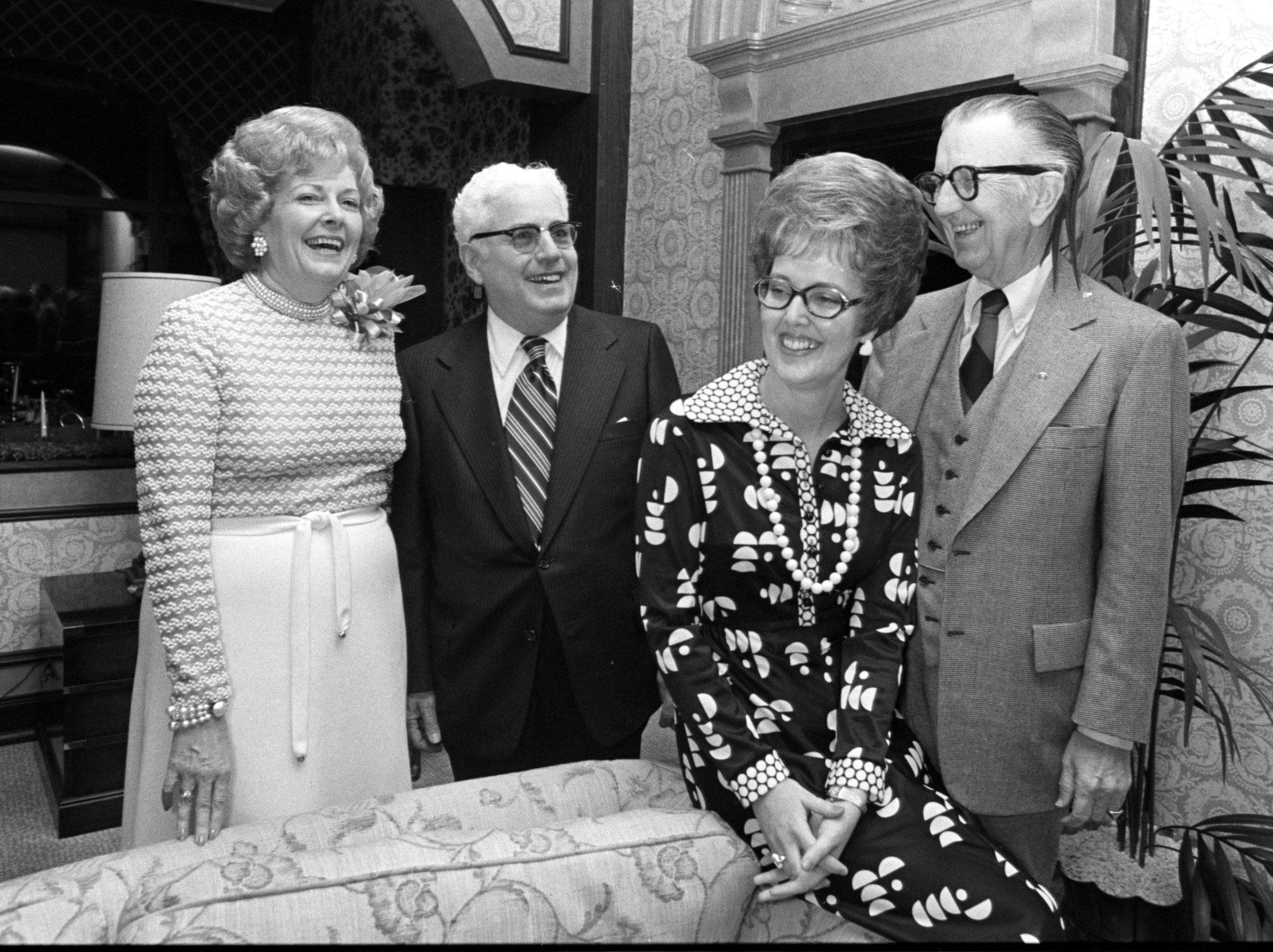 Bosses were special guests when the Executive Secretaries, Inc. had an installation dinner at Chickasaw Country Club on 16 Jan 1975. In the gathering were (From Left) Mrs. Juanita Barnes, new president, and her employer, Thomas Clark, and Mrs. James L. McNeer and her boss, E.A. 'Bob' Alburty.