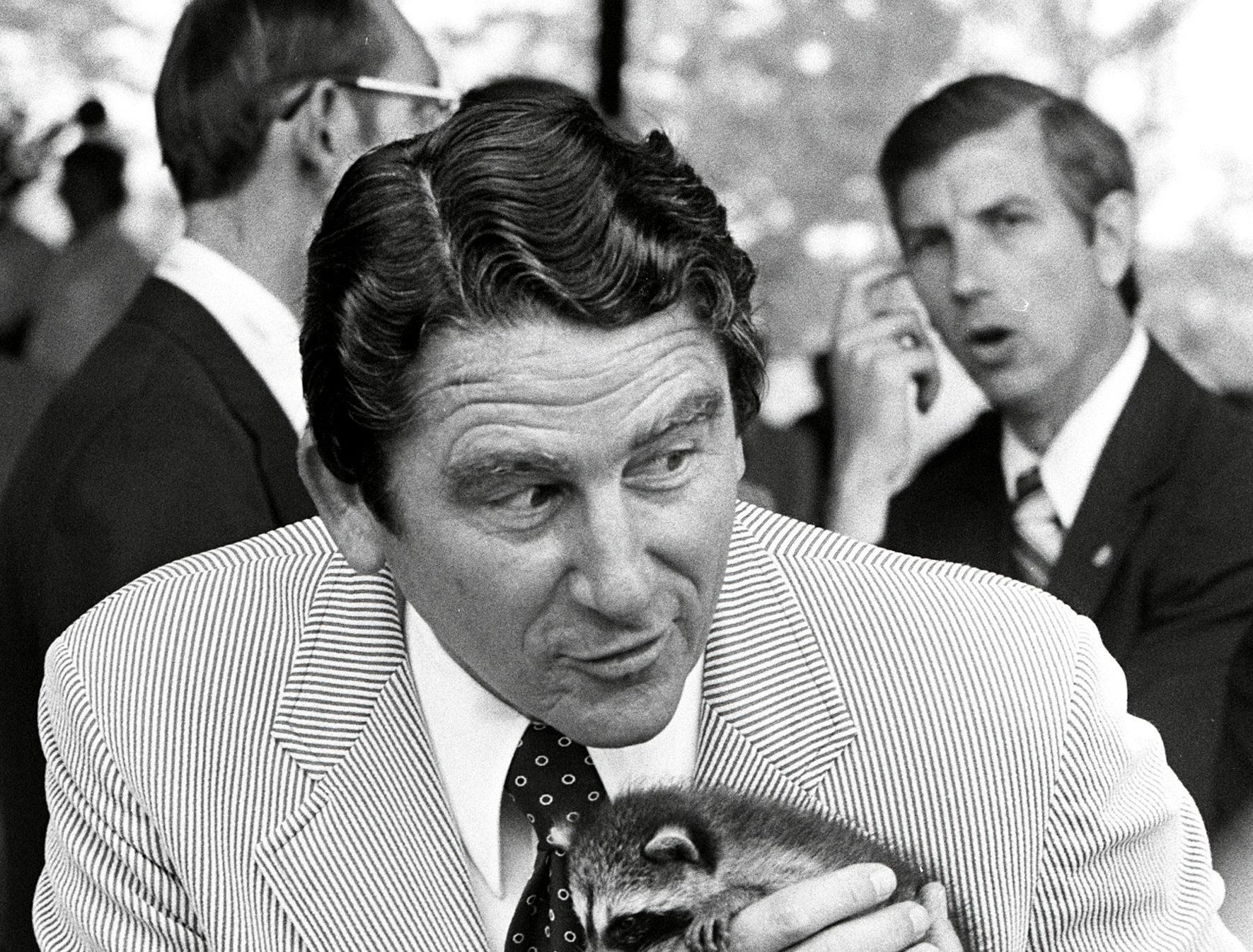 Tennessee Governor Winfield Dunn, with a borrowed raccoon, along with other political leaders from Tennessee and Mississippi attended the beginning work on the northern end of the Tennessee-Tombigbee Waterway at Yellow Creek Port, north of Iuka, MS on 8 Jul 1974.     Work on the southern portion of the $514 million waterway began near Livingston, AL in December 1972.  When the waterway is completed, possibly in 1981,it will provide a navigable link between the Tennessee River and the Gulf of Mexico.